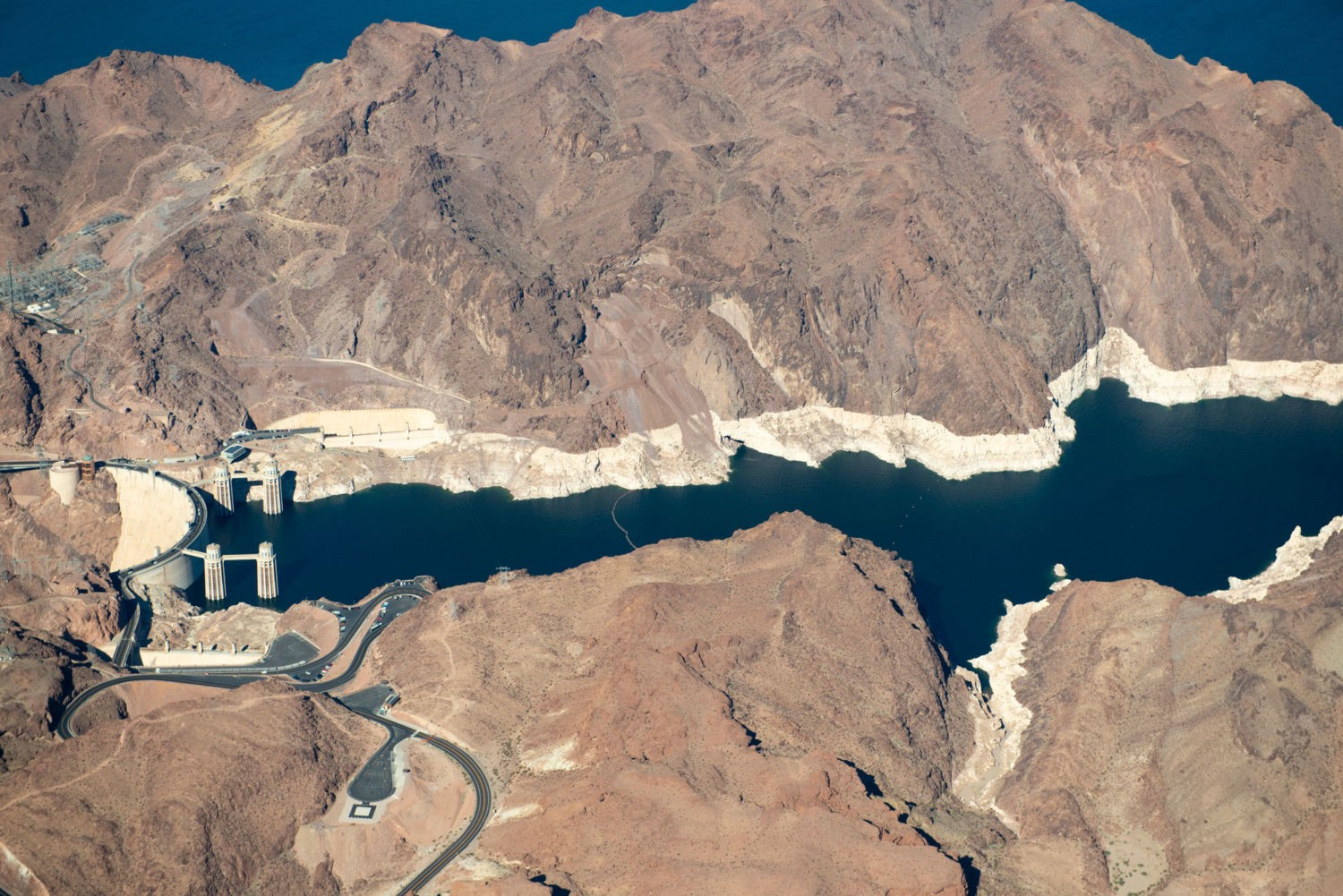 An aerial photo of Lake Mead, showing a visible water line where the water level has dropped from previous levels.