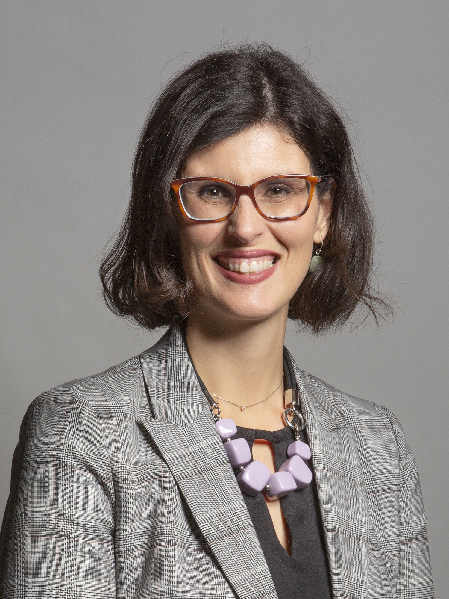 A photo of Layla Moran MP wearing a business suit and looking directly at the camera