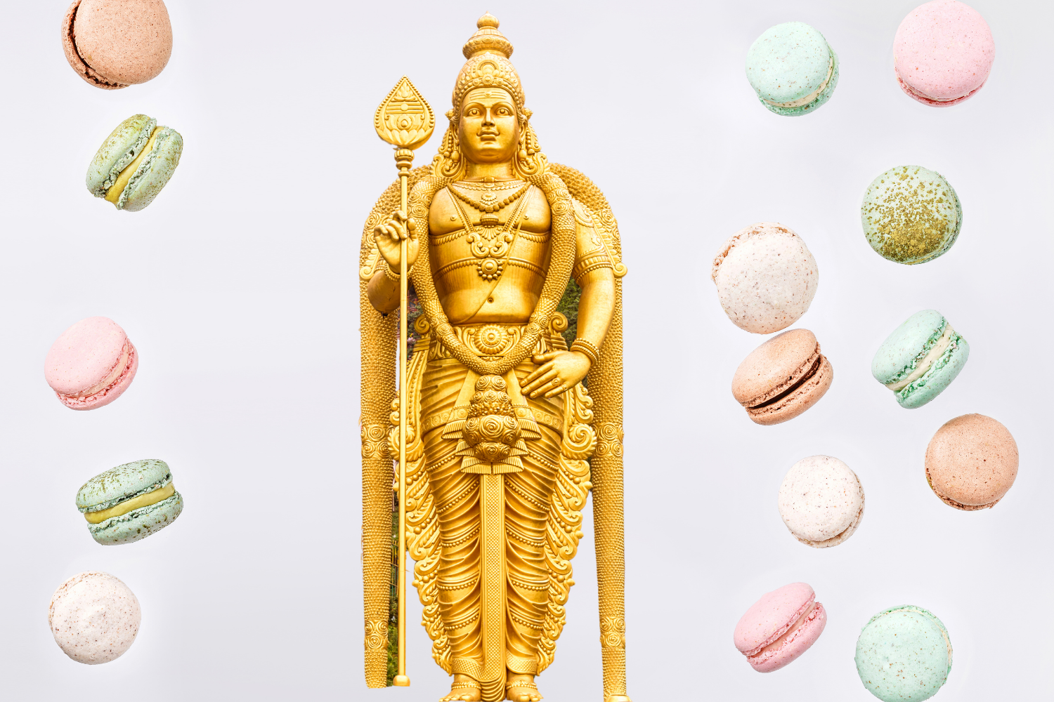 Golden statue surrounded by macarons