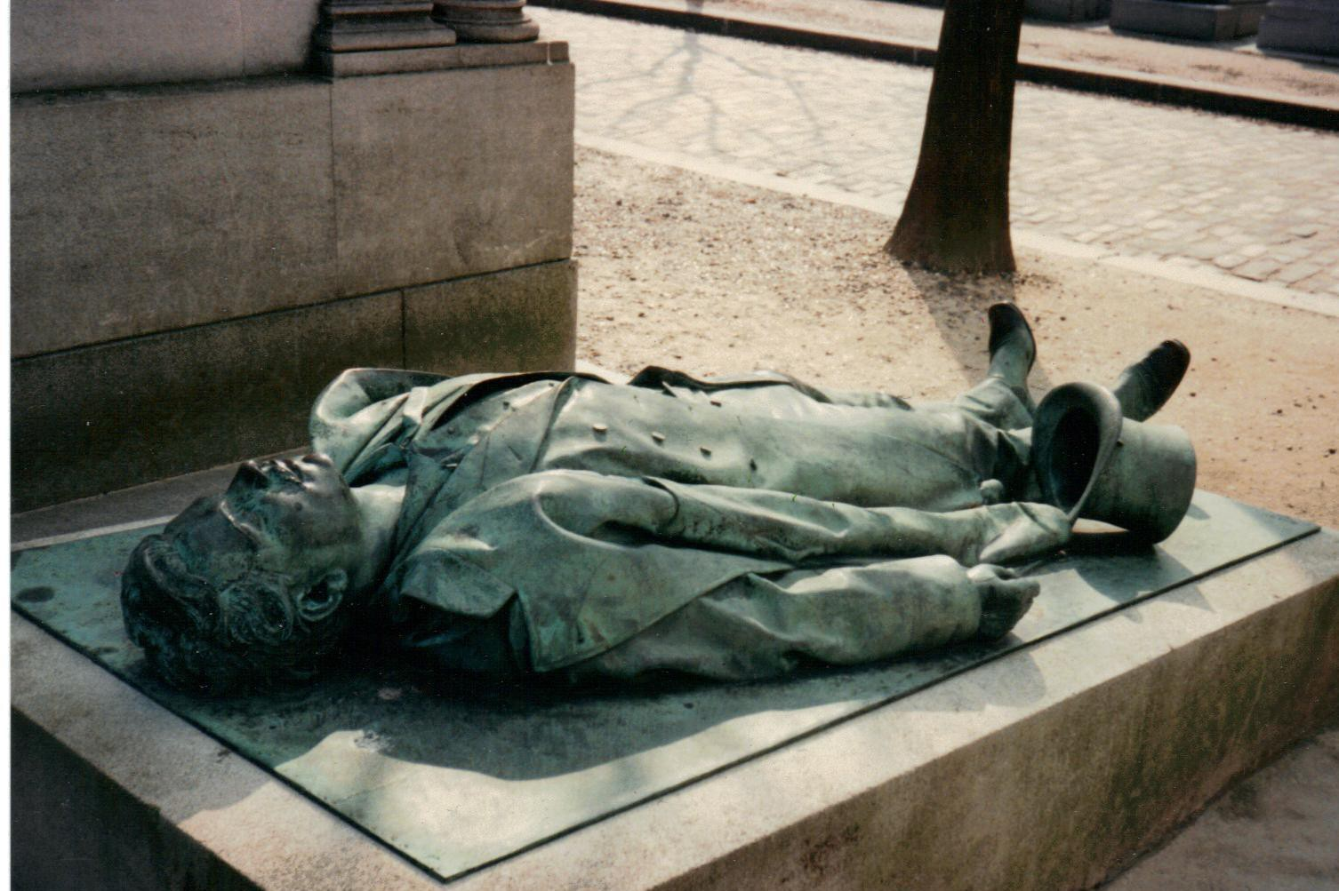 Victor Noir's tombstone depicts him as he was shot dead.