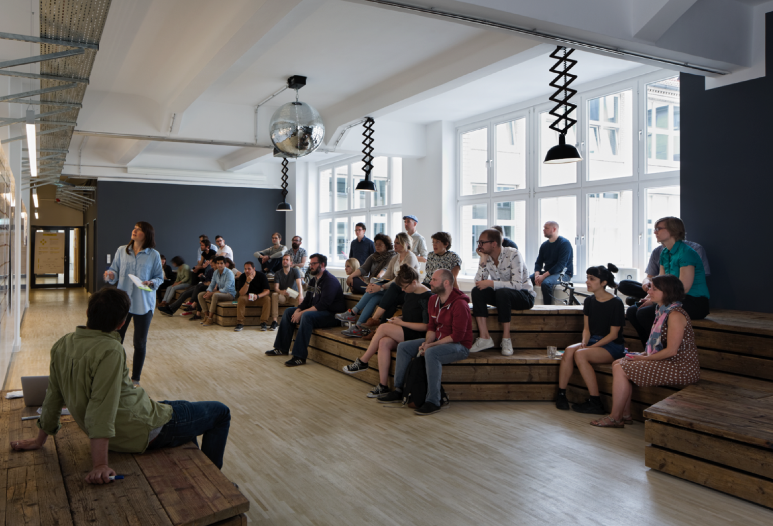 A group of people attending a presentation at Fjord's office in Sweden