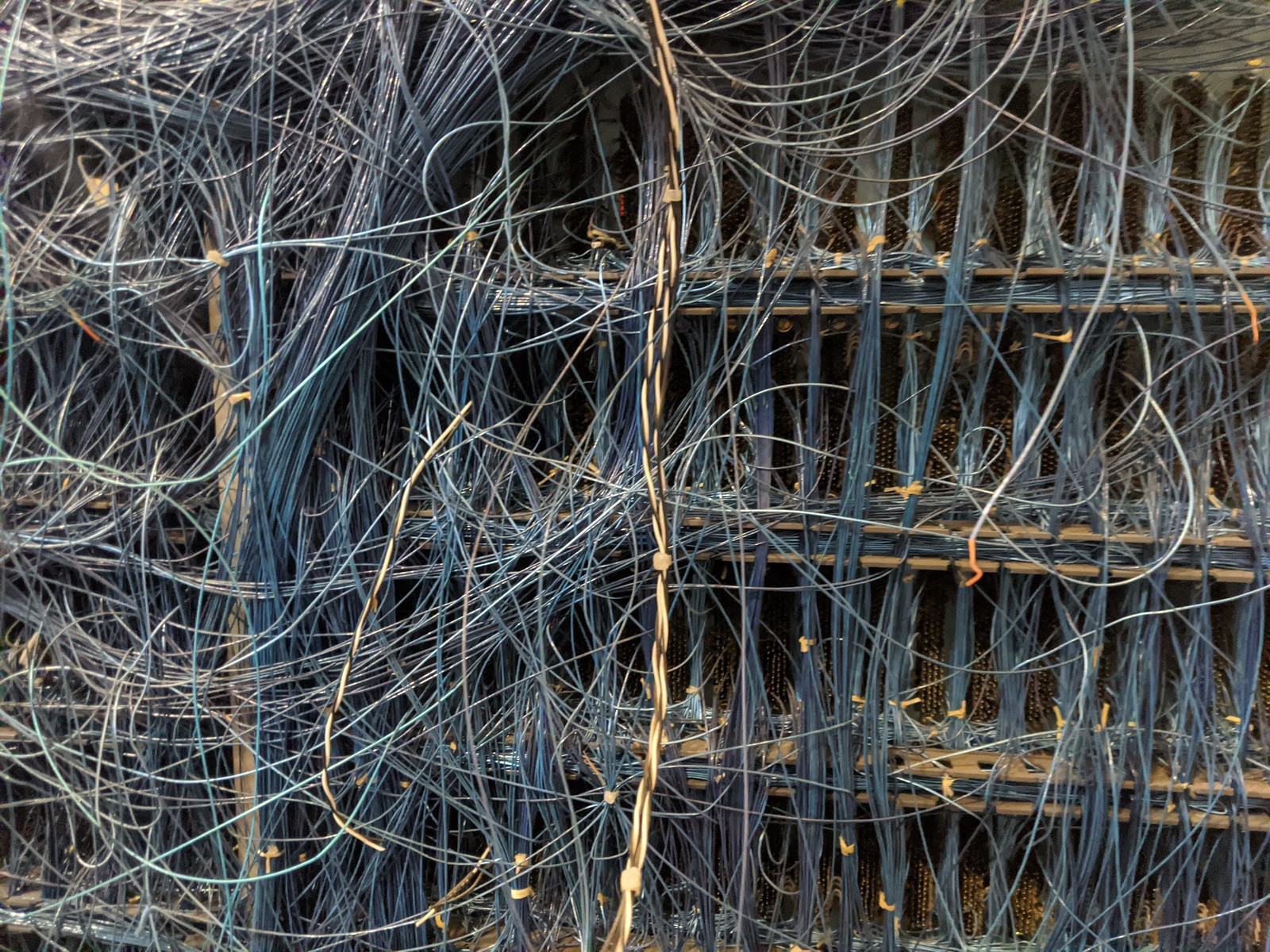 The complex, hand-wired backplane of an electromechanical supercomputer at the Computer History Museum boneyard; it is an impossible tangle of wires joining various subassemblies.