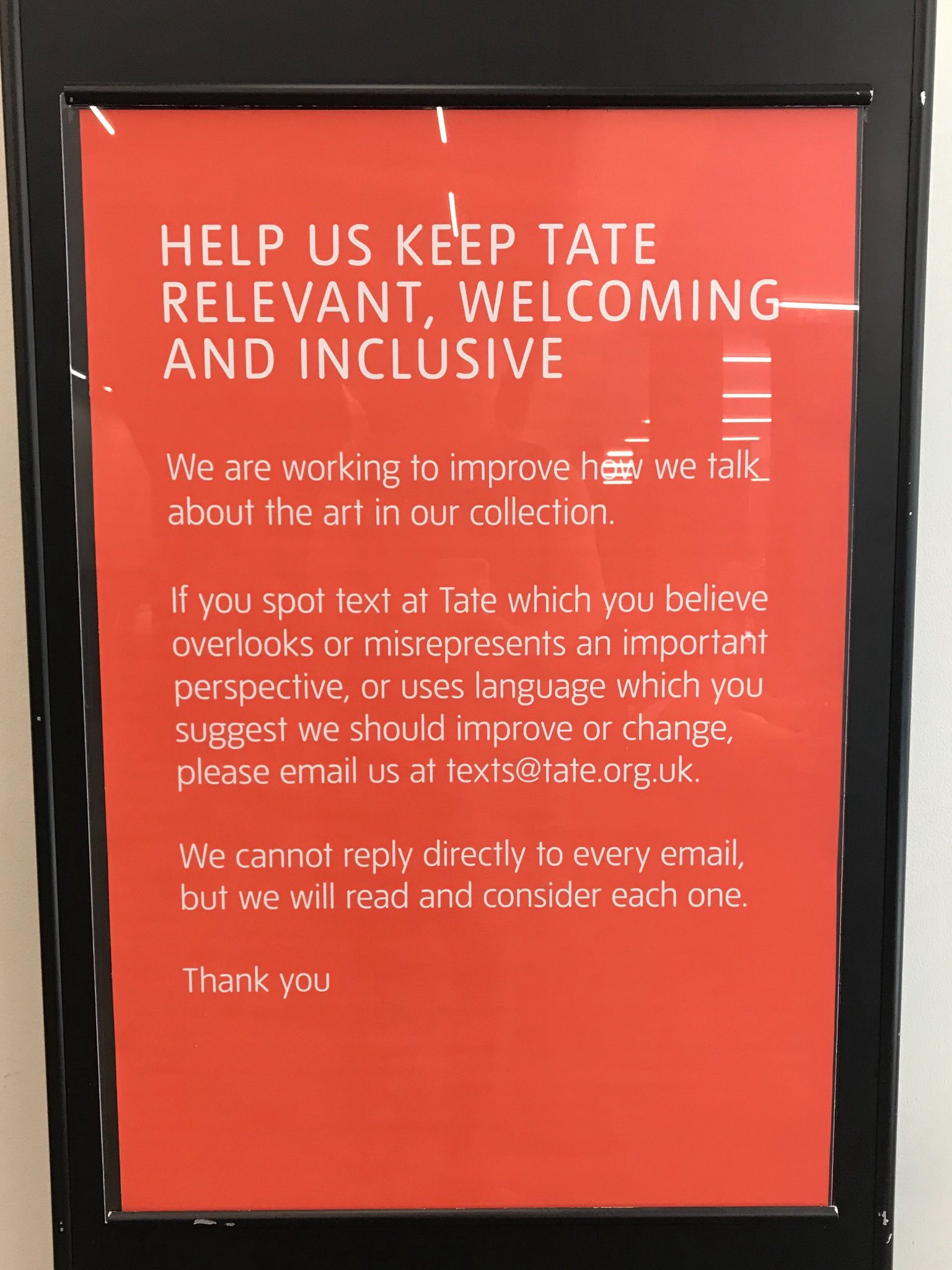 A text-only sign from the Tate Museum with the headline: Help Us Keep Tate Relevant, Welcoming and Inclusive.