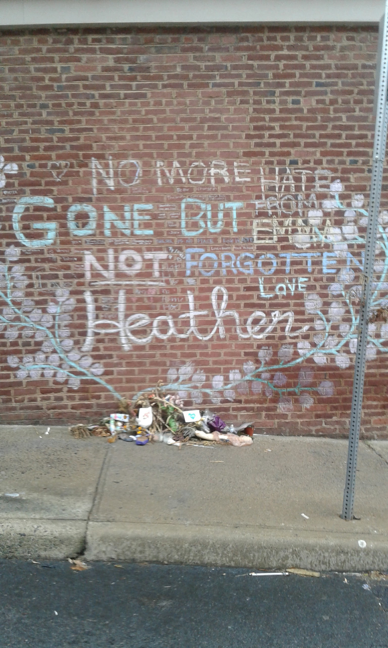 The memorial for Heather Heyer of flowers and signs at the site of her death.