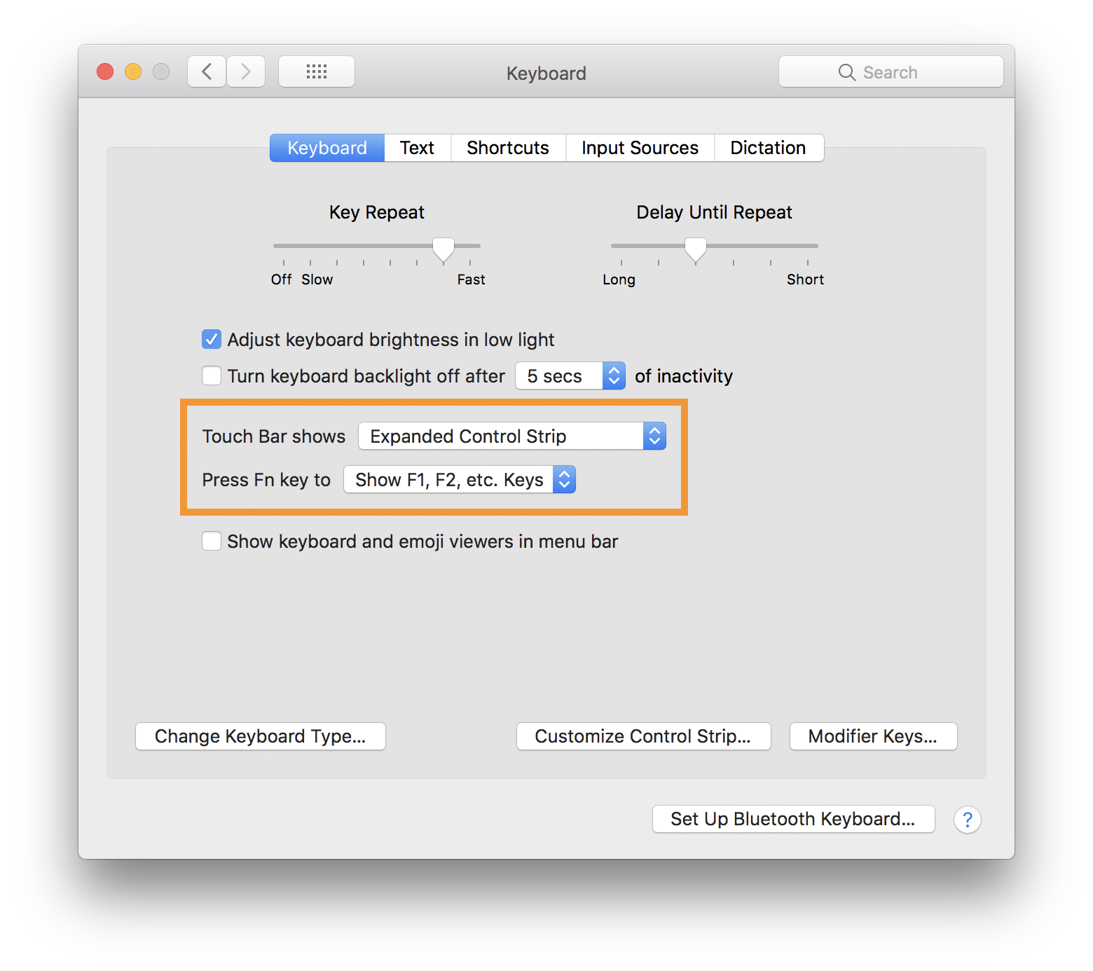 "Screenshot of the macOS Keyboard Settings panel. The ""Touch Bar Shows"" and ""Press Fn key to"" controls are highlighted with an orange border."