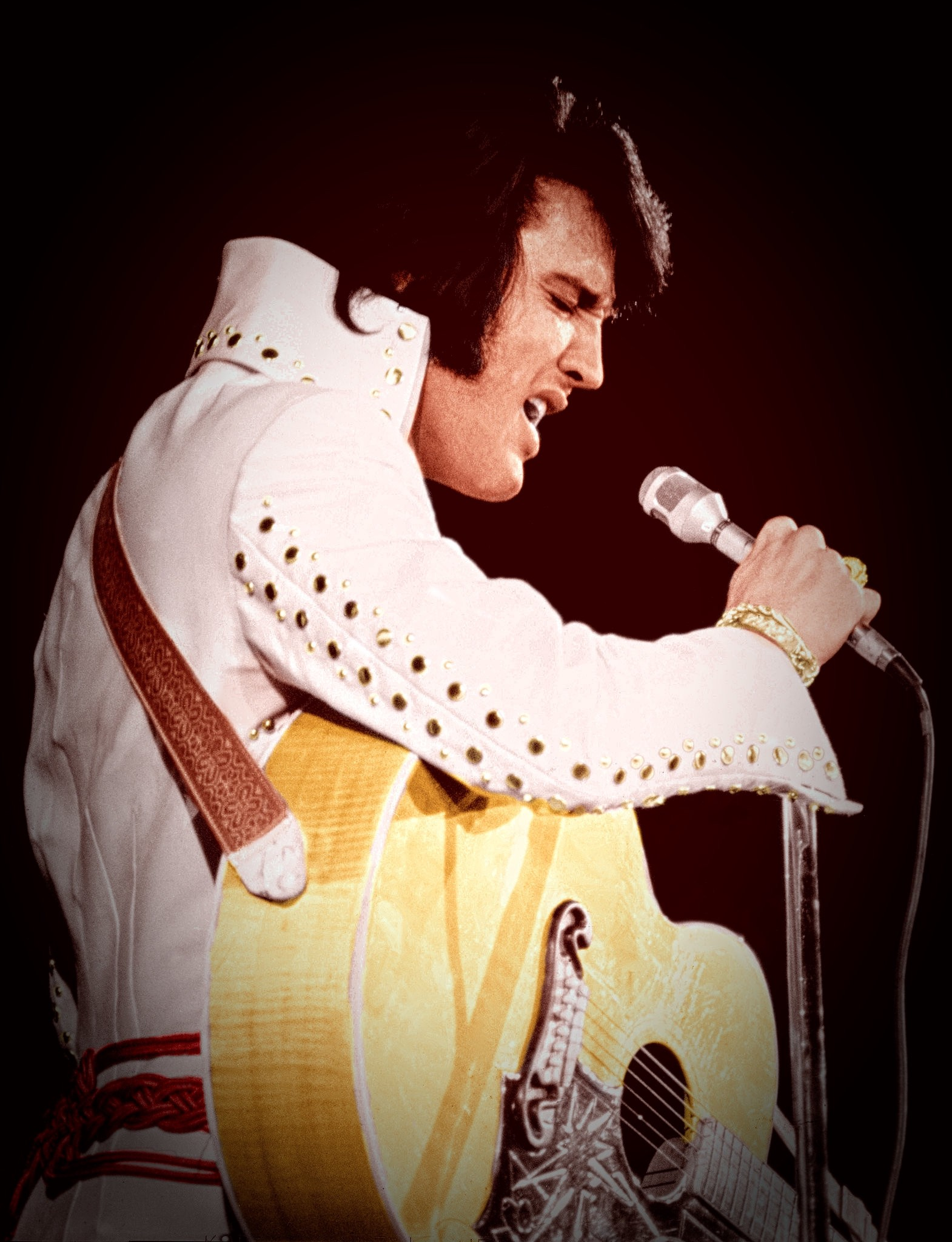 Elvis Presley grasps a microphone and cuts loose in front of an 18,700-capacity crowd at the Inglewood Forum in November 1970