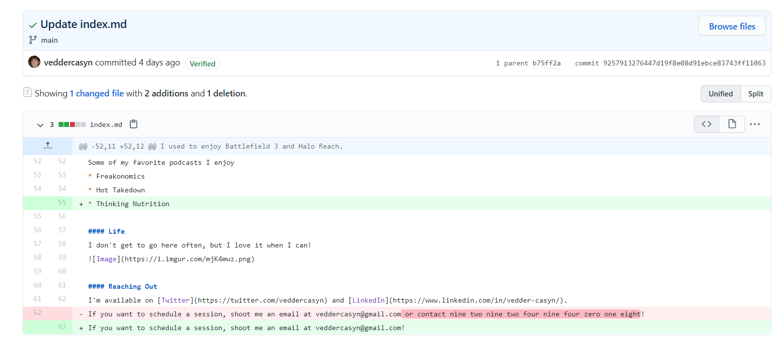 A screenshot of a GitHub commit containing a phone number