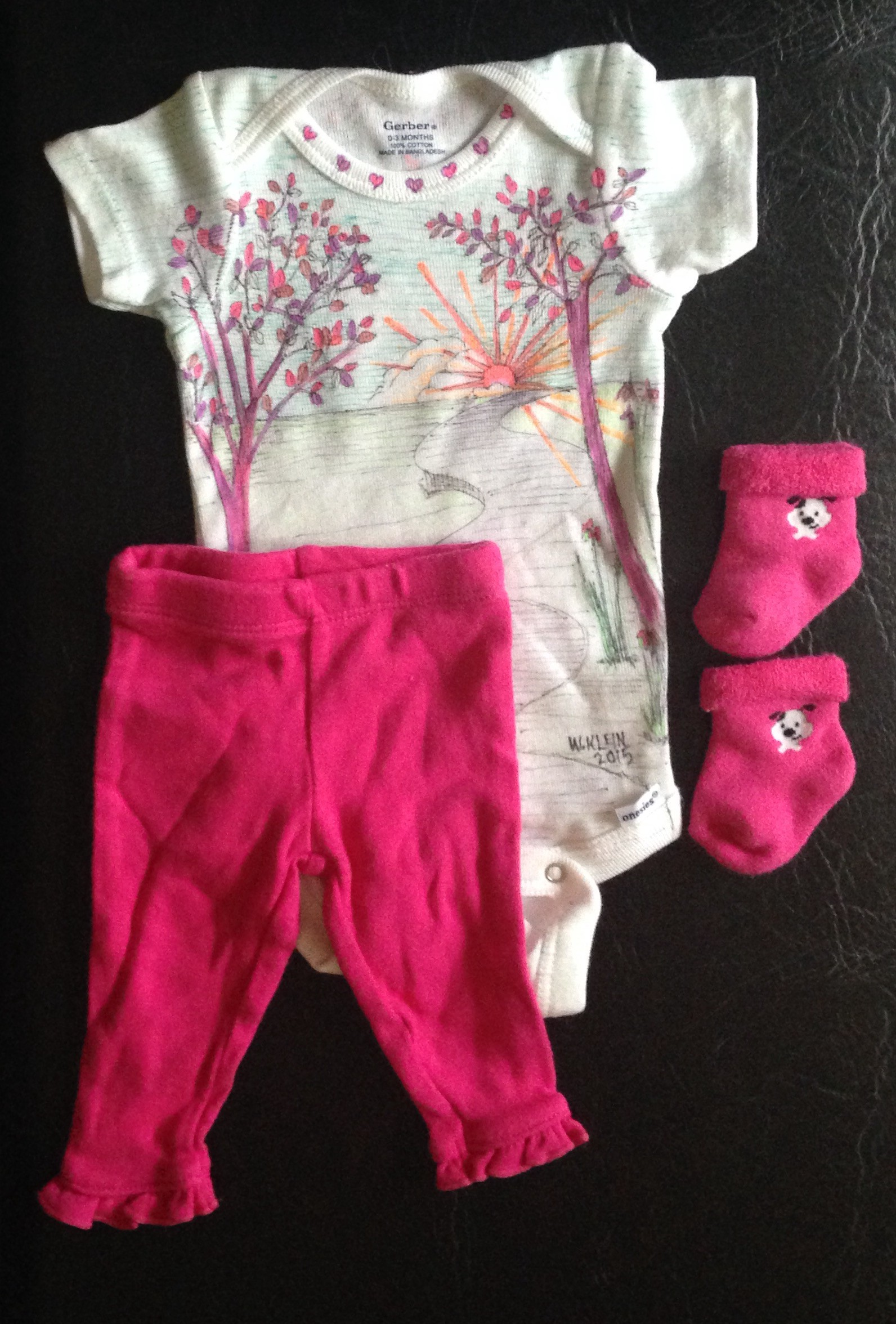 27b1899253fbe So I make these really cute, hand painted baby clothes.