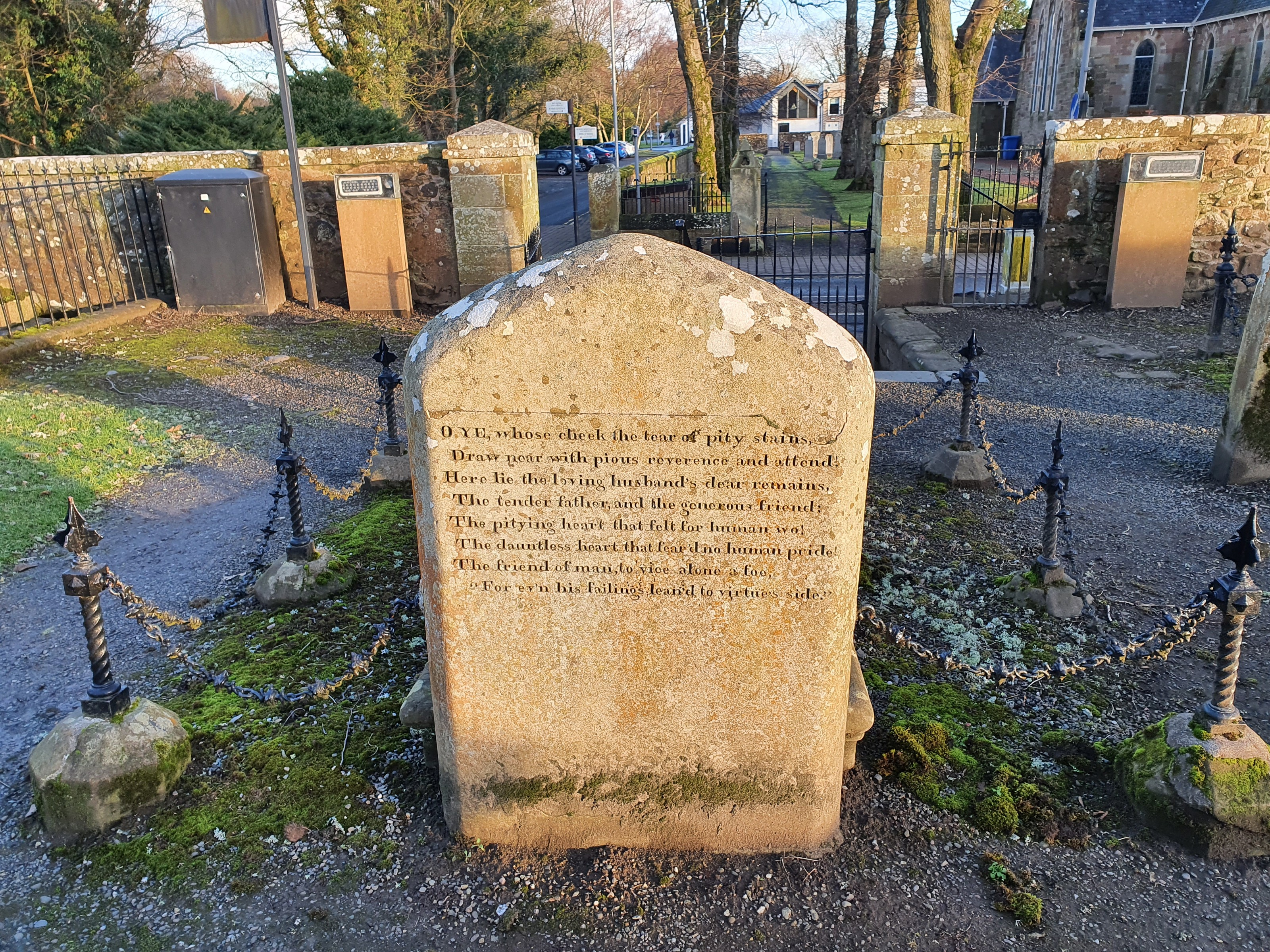 A grave stone is singled out in a graveyard. This is the grave of William Burns. Father of the famous poet Robert Burns