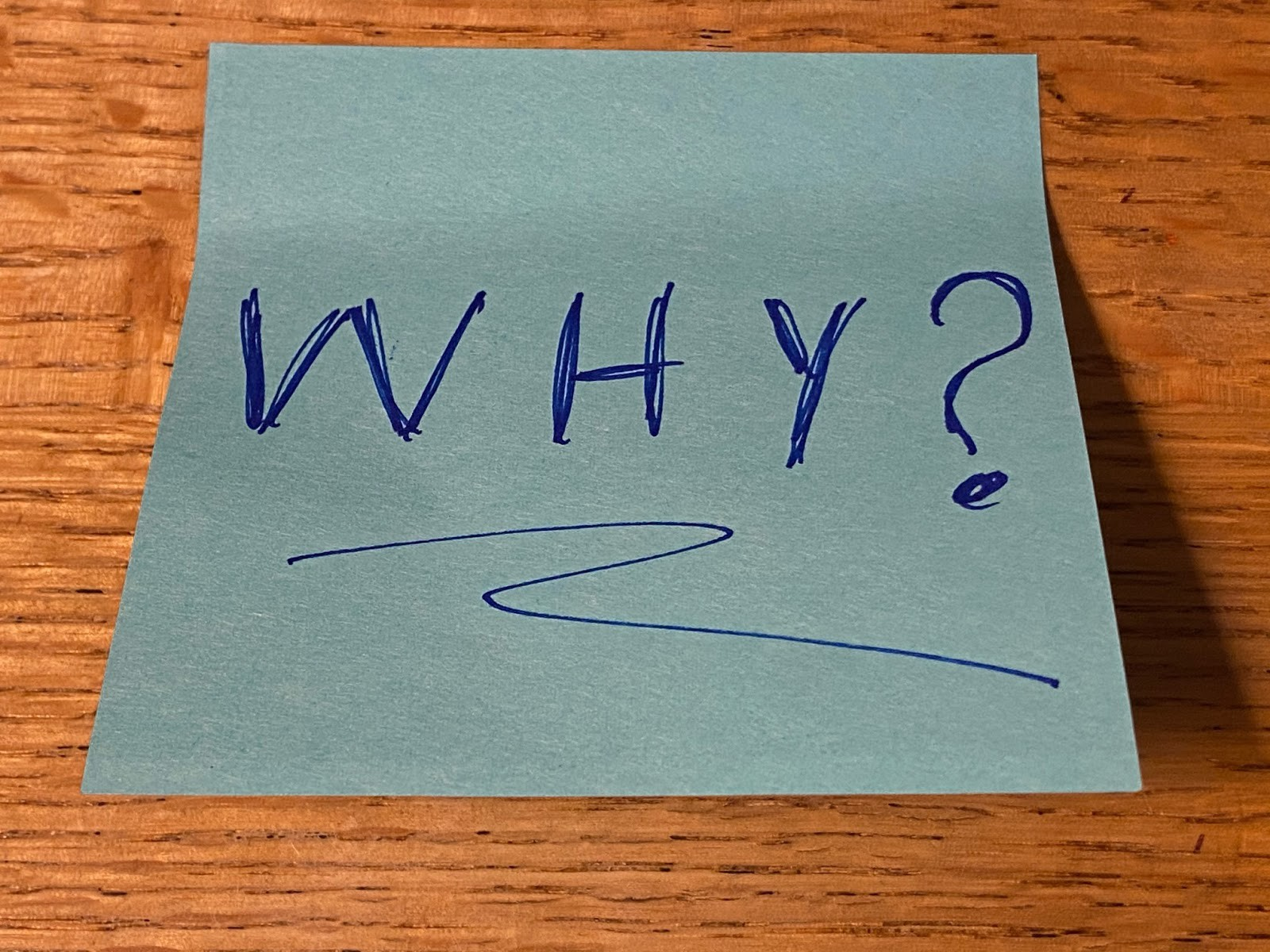 A post it note with the word WHY? Why fibrosarcoma