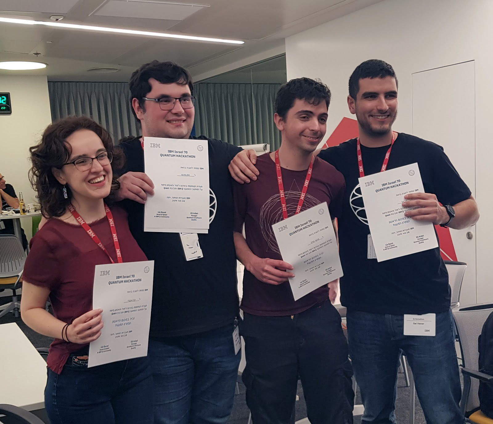 Four students holding certificates