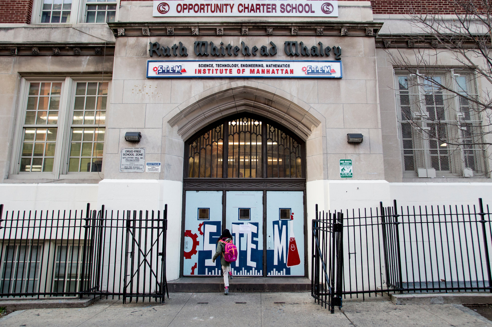 The picture depicts the entrance of the STEM Institute of Manhattan, with the doors closed.