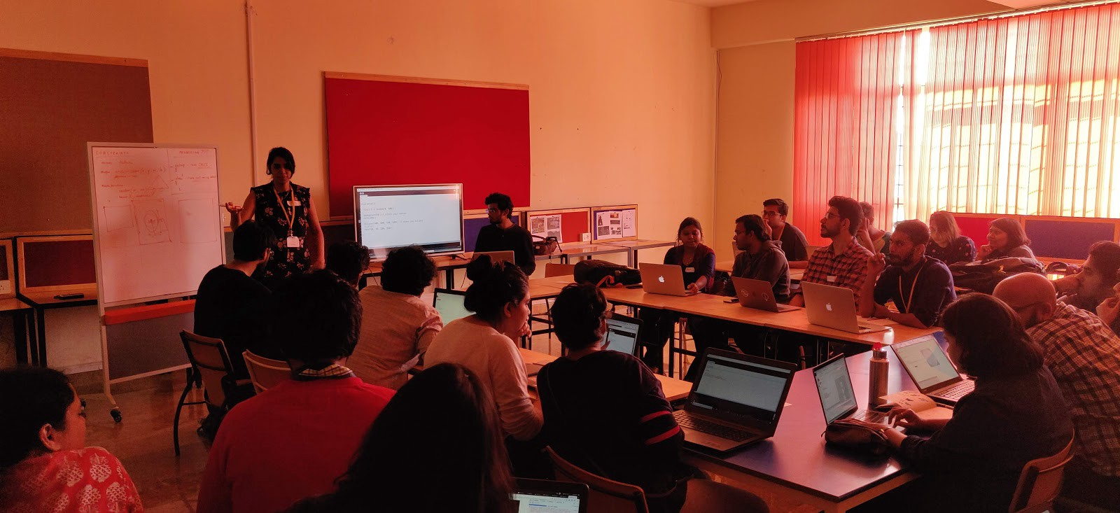 """Participants in the """" Generative Futures"""" workshop working on their laptops"""