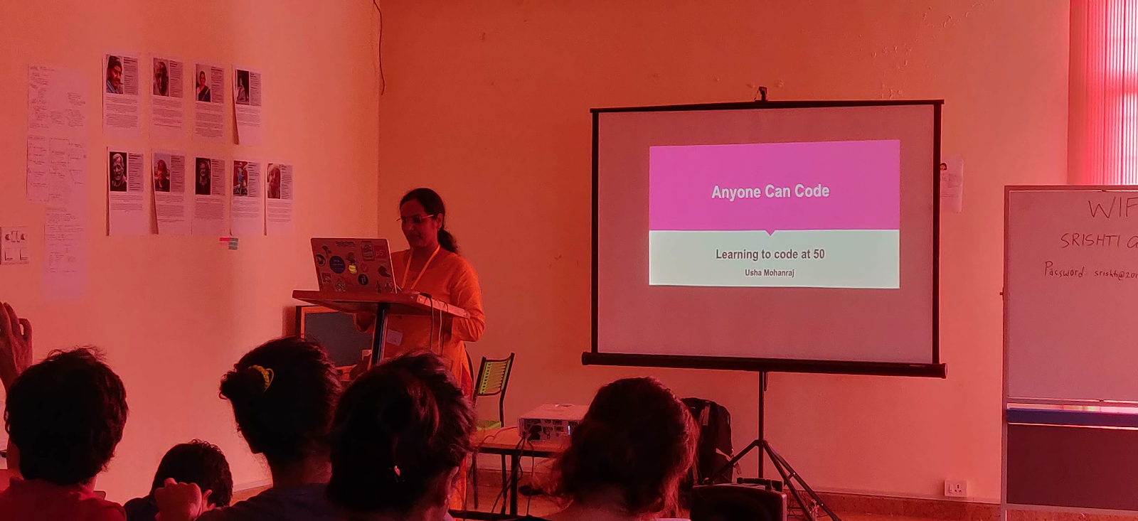"""Usha Mohanraj presenting her talk """"Anyone Can Code: Learning to code at 50"""""""