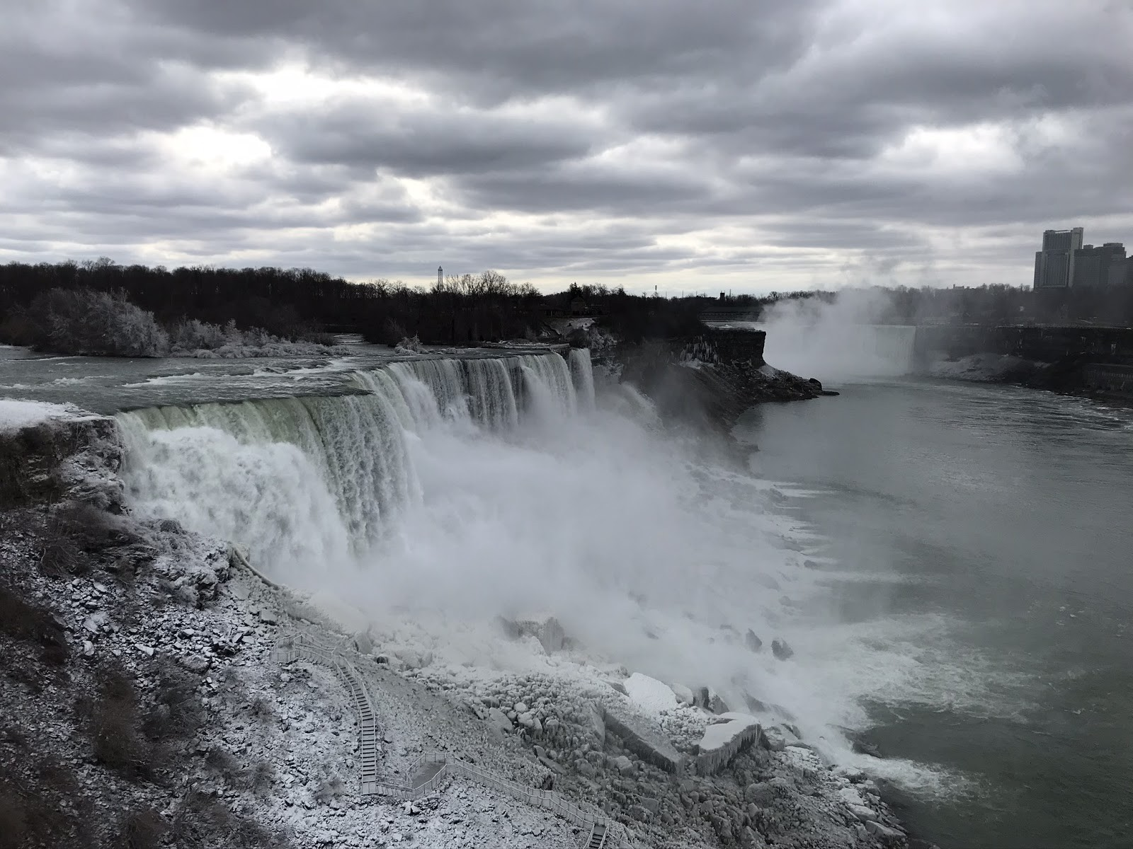 View of Niagara Falls in the winter with a cloudy sky from the Niagara Falls Observation Tower.