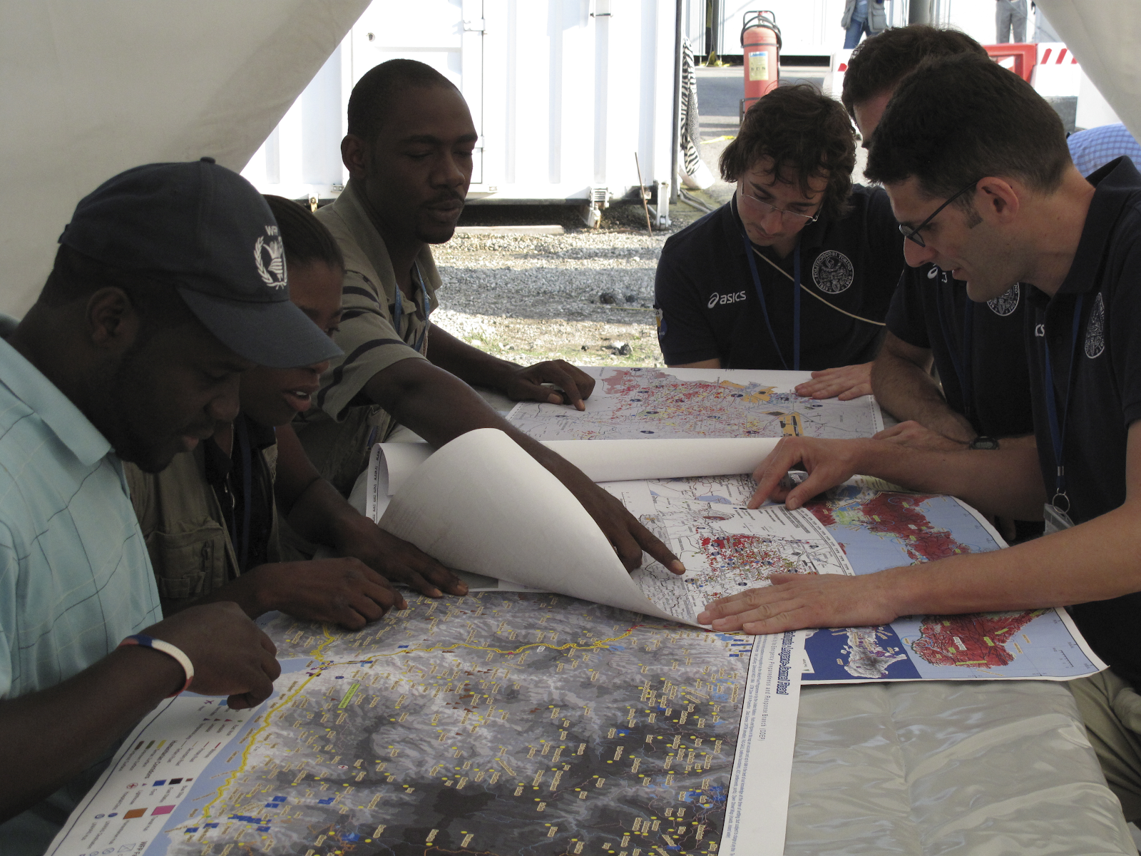 Humanitarians on the field using maps.