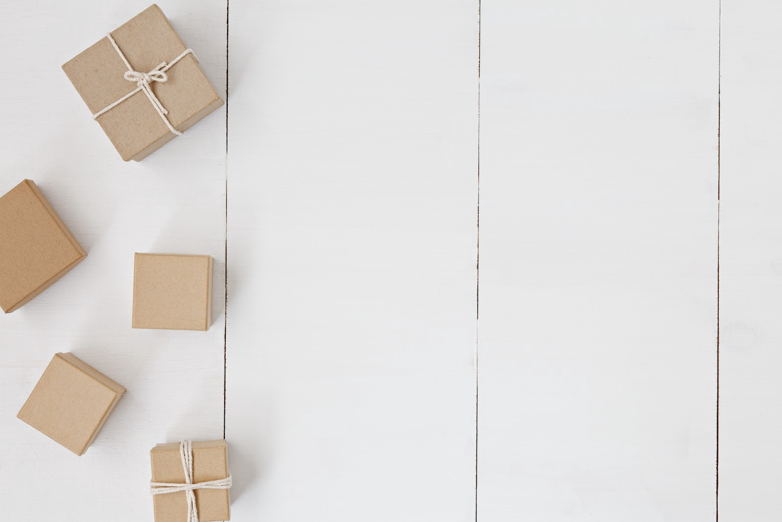 Delivery boxes lined up on a neutral background