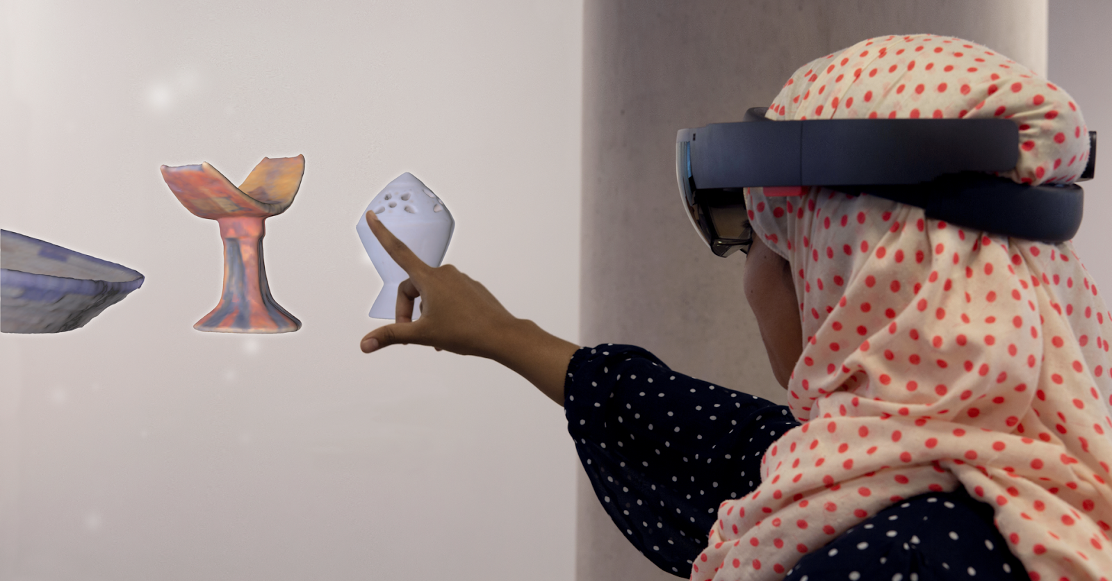 Photo of a person wearing an AR headset interactive with holographic objects