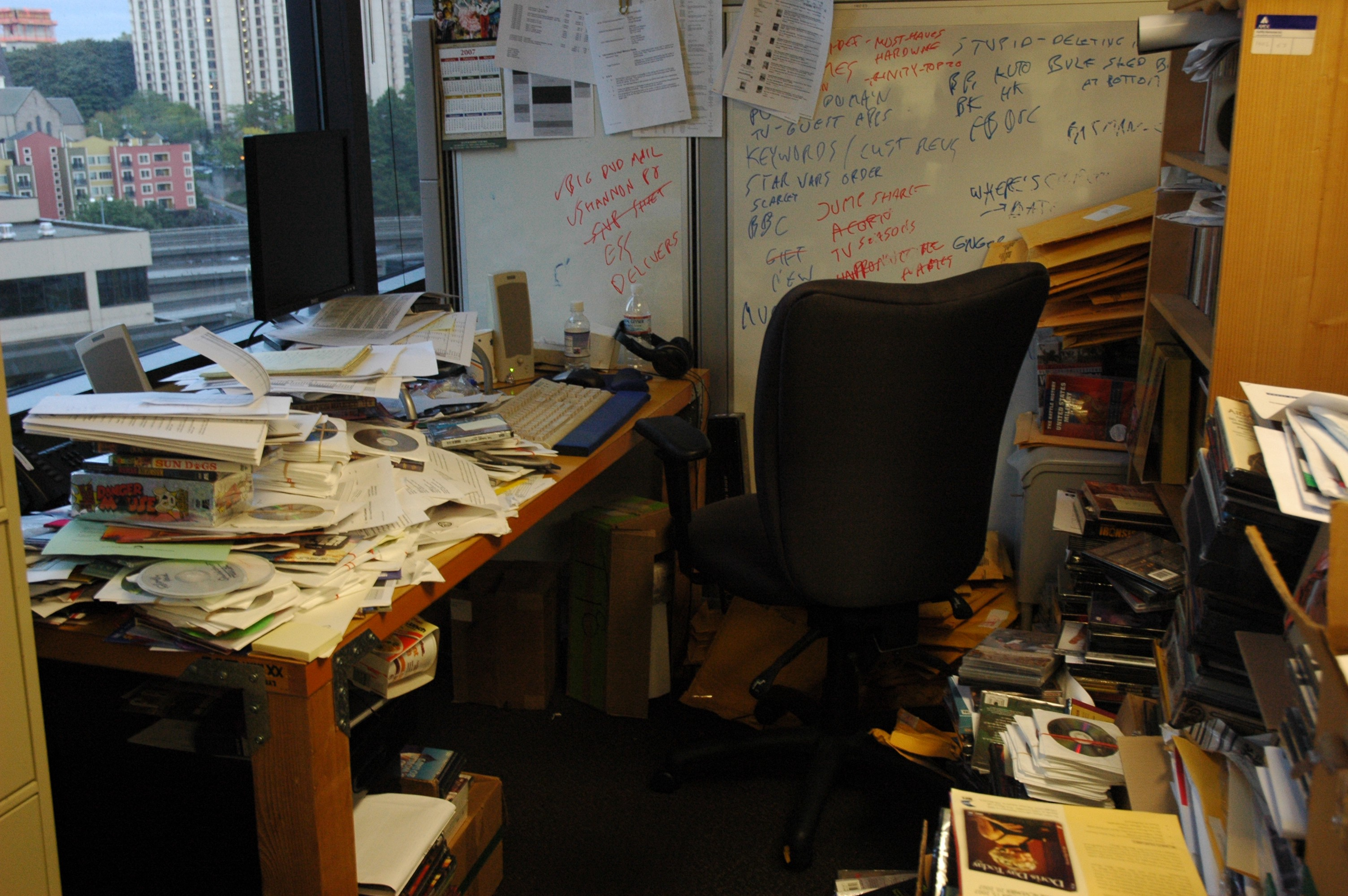 A messy desk with stacks of paper.