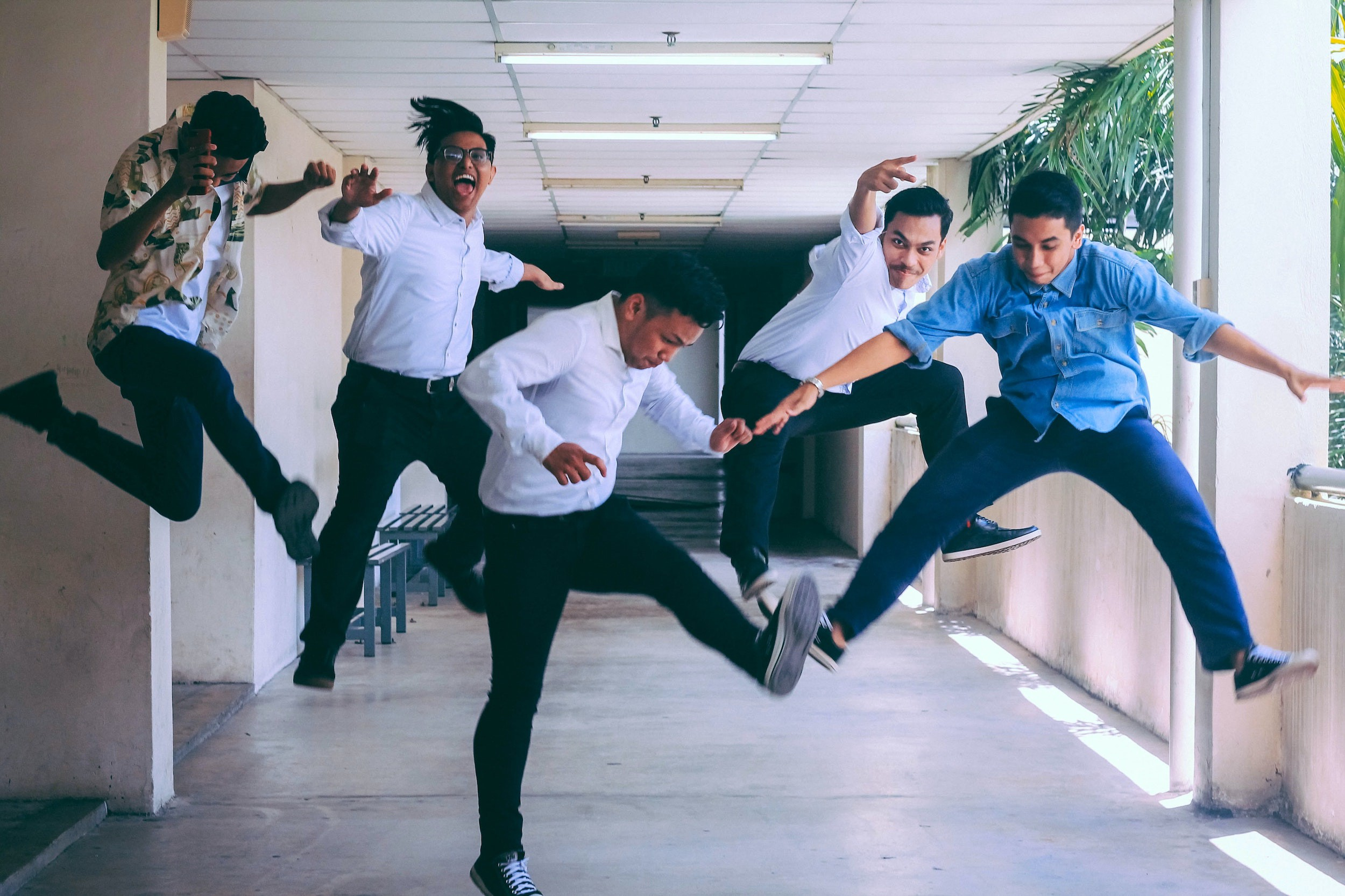 Five people jumping happily.