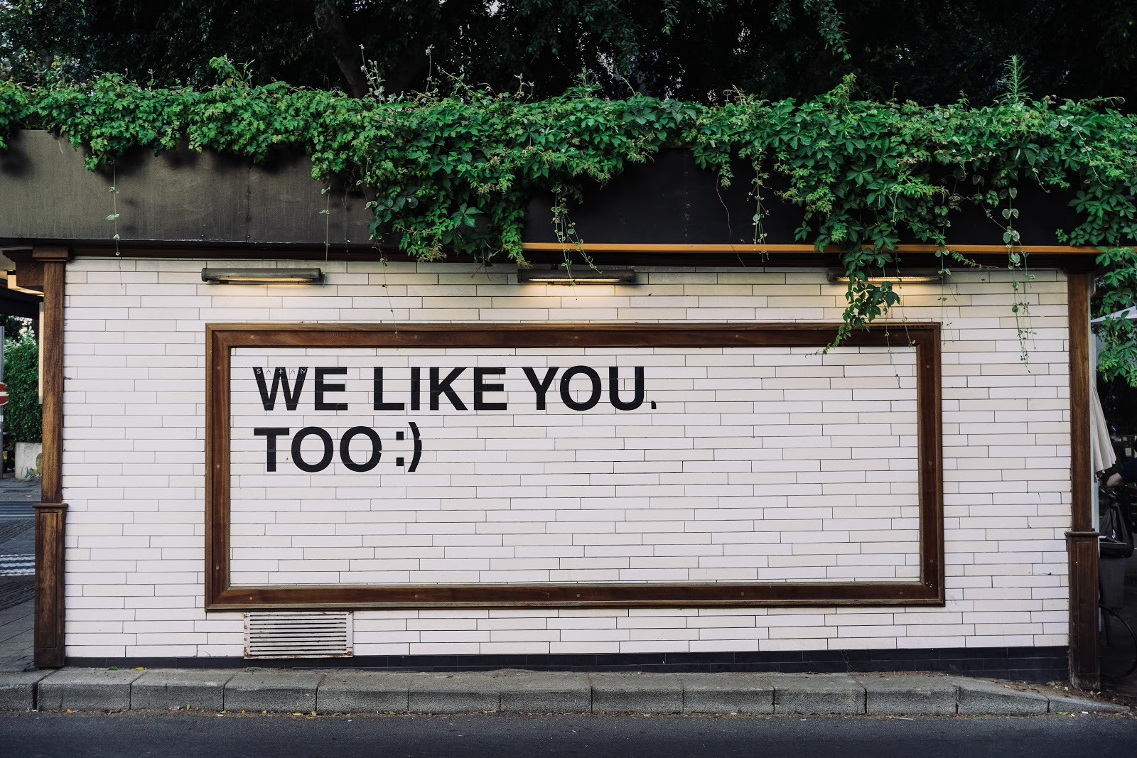 """Sign with the words """"We like you too"""" and a smiley face"""