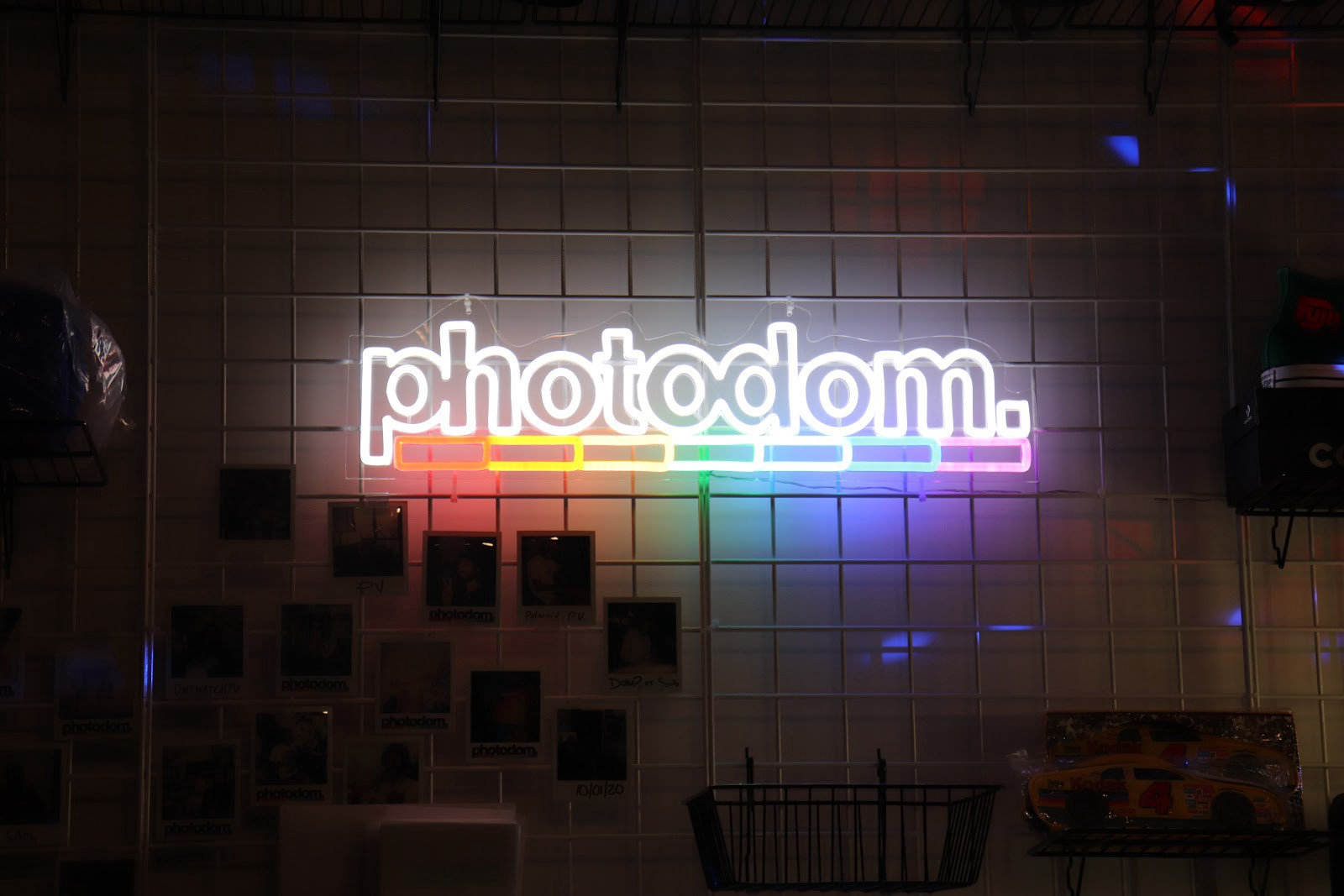 A rainbow-colored neon signage of the Photodom logo