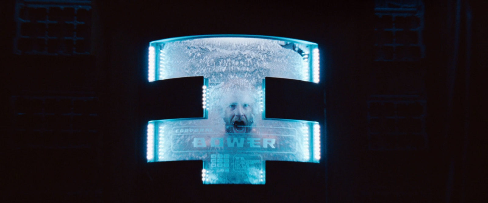 "A man screams from inside a cryogenic freezer labeled ""BOWER"""