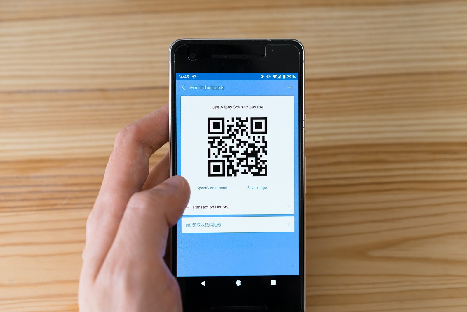 A user making payment through mobile payment app