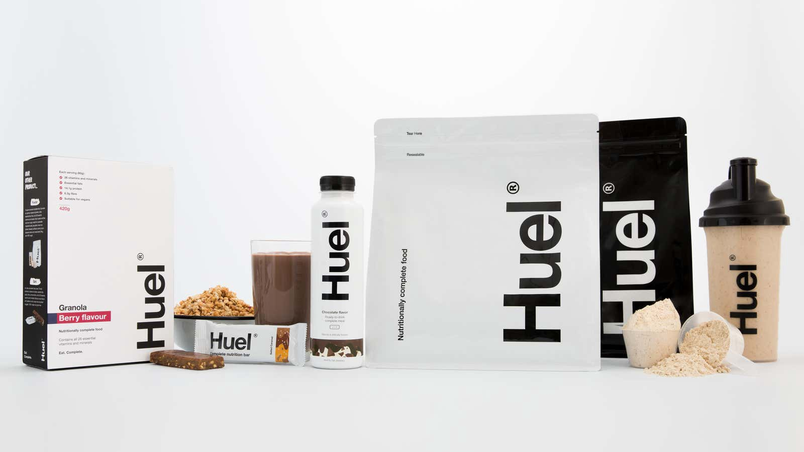 A range of Huel products, including powders, shakes, bars and a reusable container.