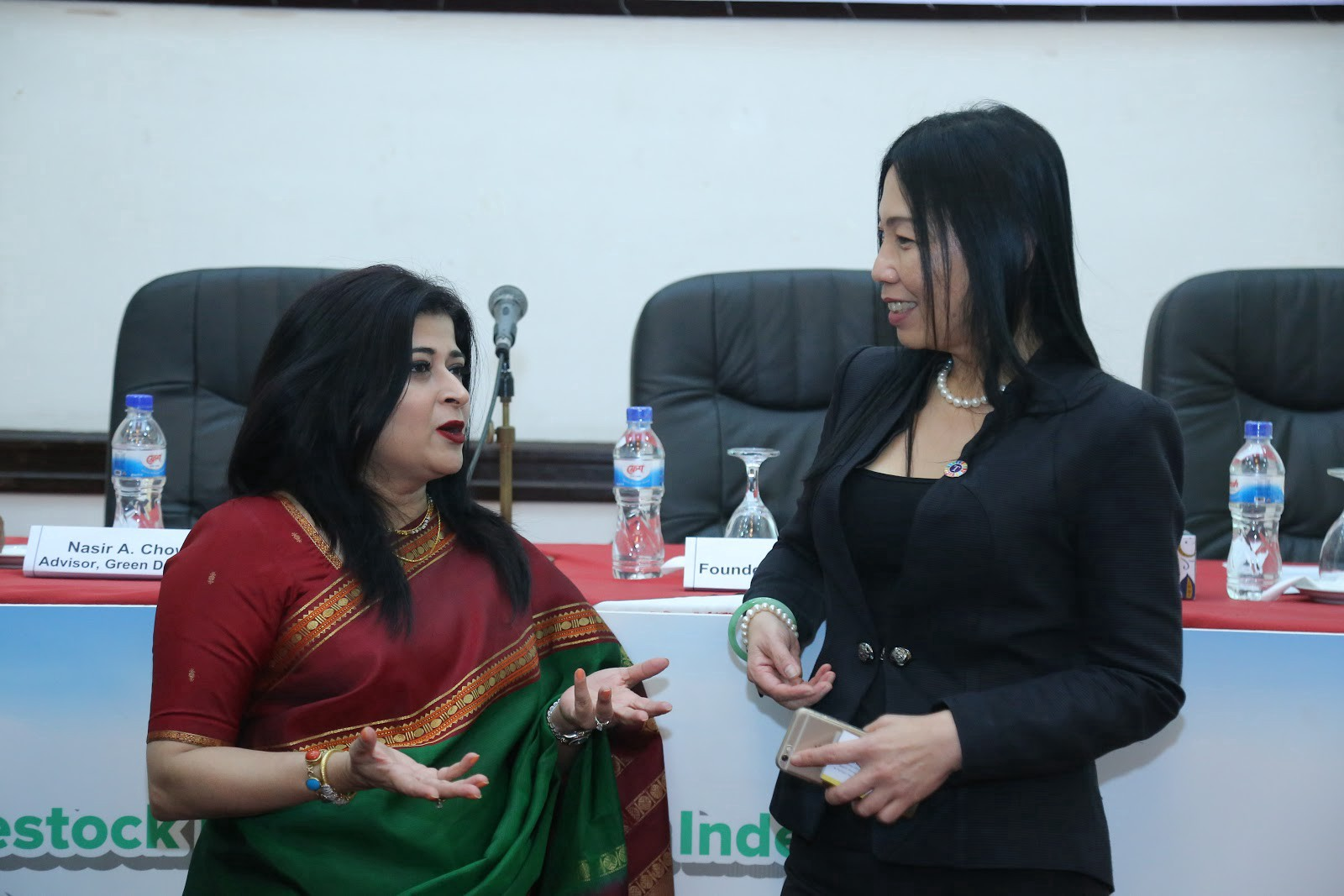Ms. Chowdury, an SDG Pioneer discussing the Sustainable Development Goals with Chan Sue Meng, InfoCorp's Director of Strategi