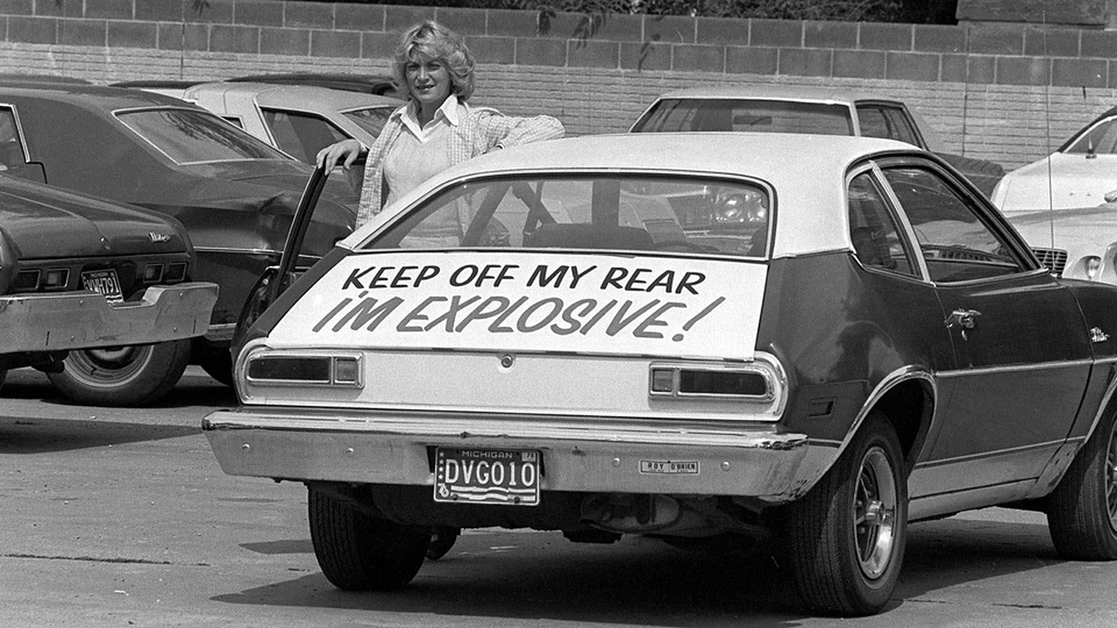 """Woman standing next to Ford Pinto: """"KEEP OFF MY REAR I'M EXPLOSIVE!"""""""