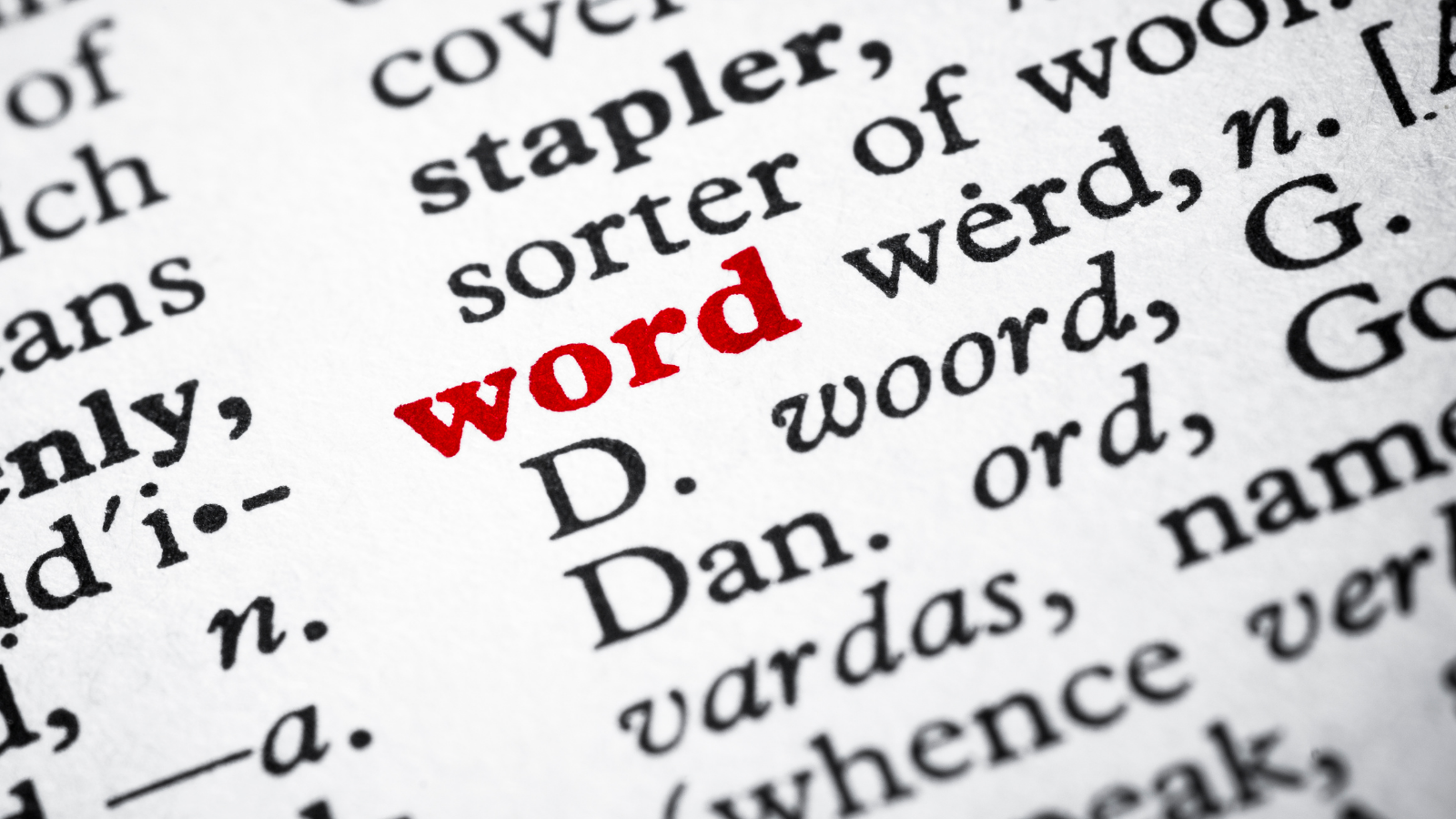 """An image of black type text surrounding the word """"word"""" in bright red."""
