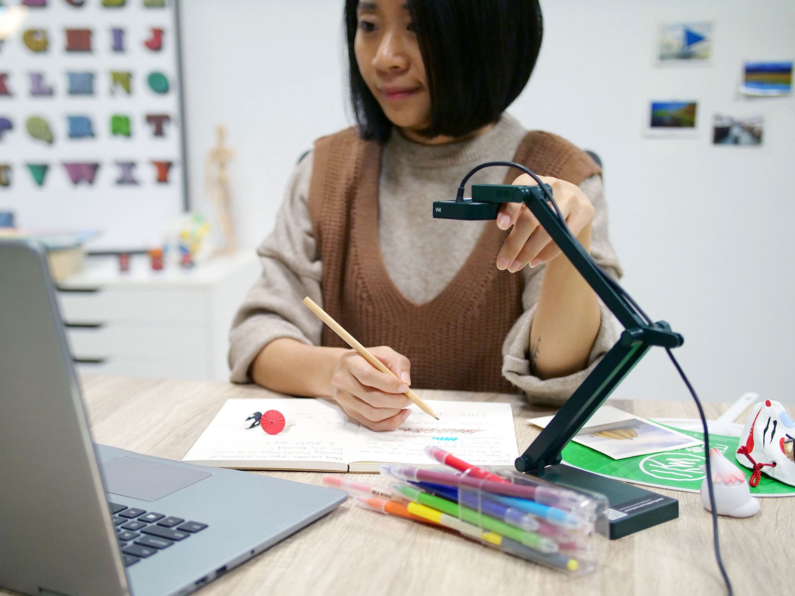Adjusting an IPEVO V4K document camera to get the perfect shot.