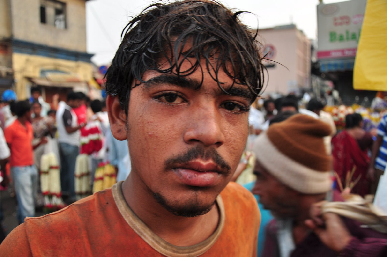 Labouror posing for a picture at the market in Bangalore
