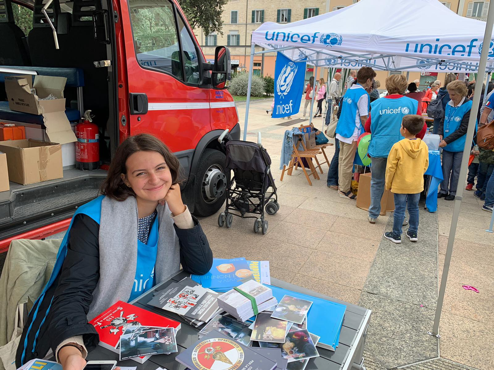 Virginia Maria Barchiesi hosting a fundraising table at a UNICEF event in Ancona, Italy.