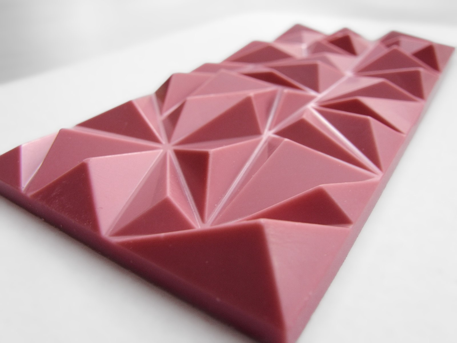 A thin bar of ruby chocolate. Instead of being scored into squares/rectangles, it's in three-dimensional triangle shapes.