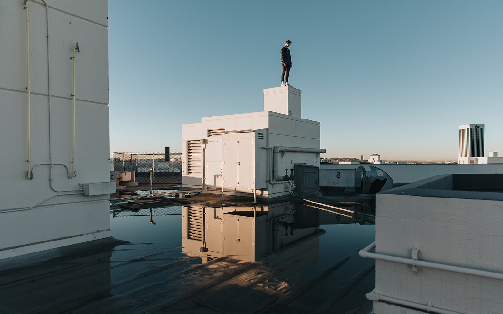 Man standing on top of a building