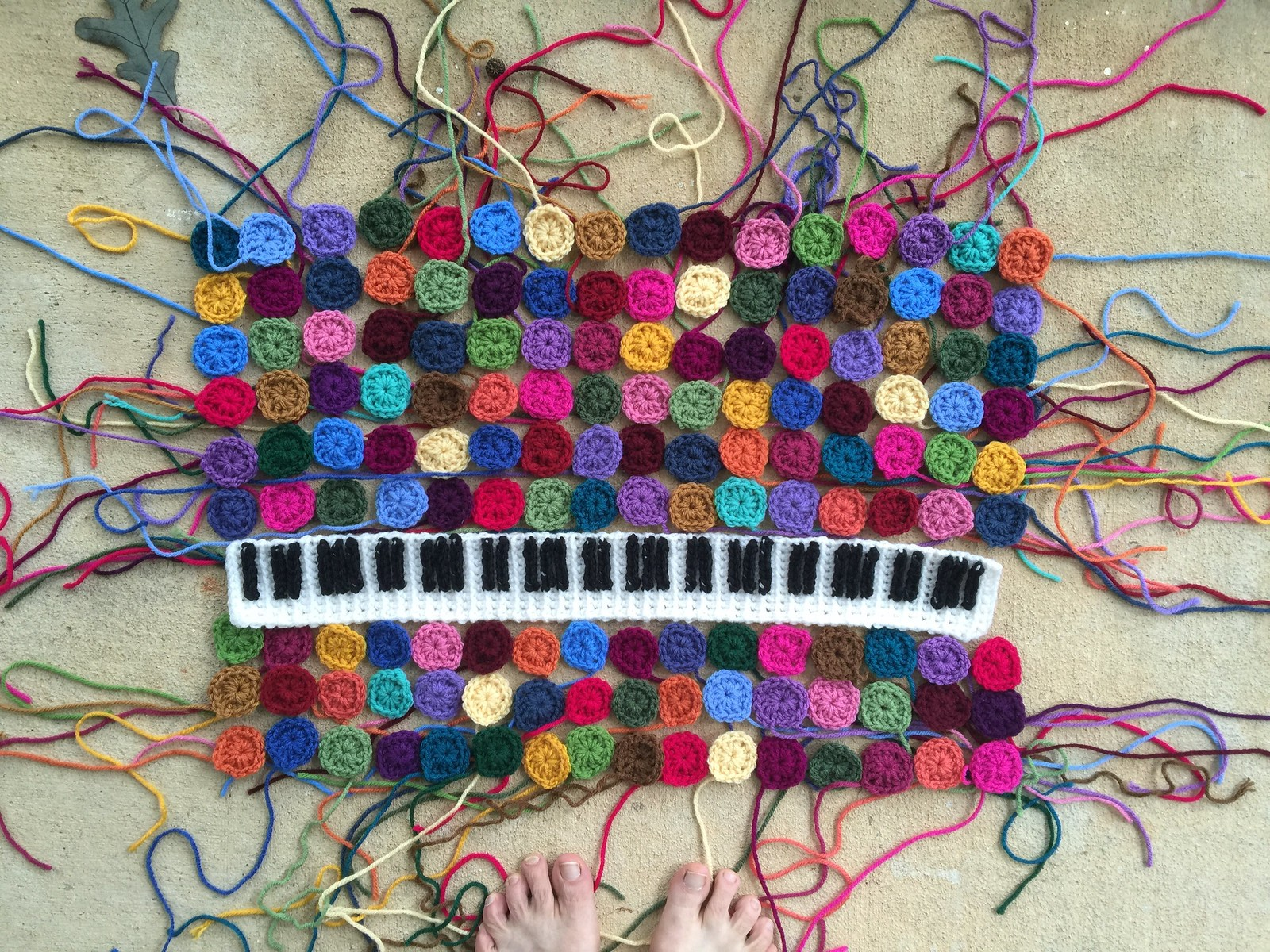 A crochet keyboard and more than one hundred one-round granny squares