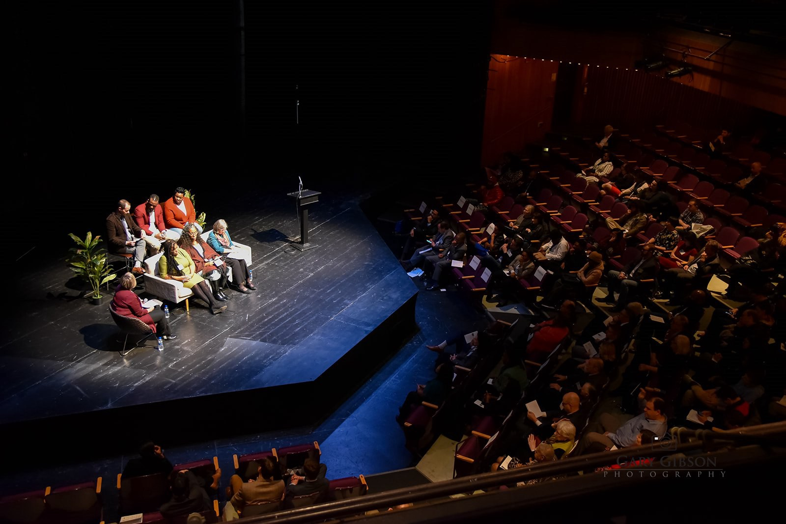 Dr. Stefanie DeLuca interviews panelists for the Thompson 25 event at Baltimore Center Stage.