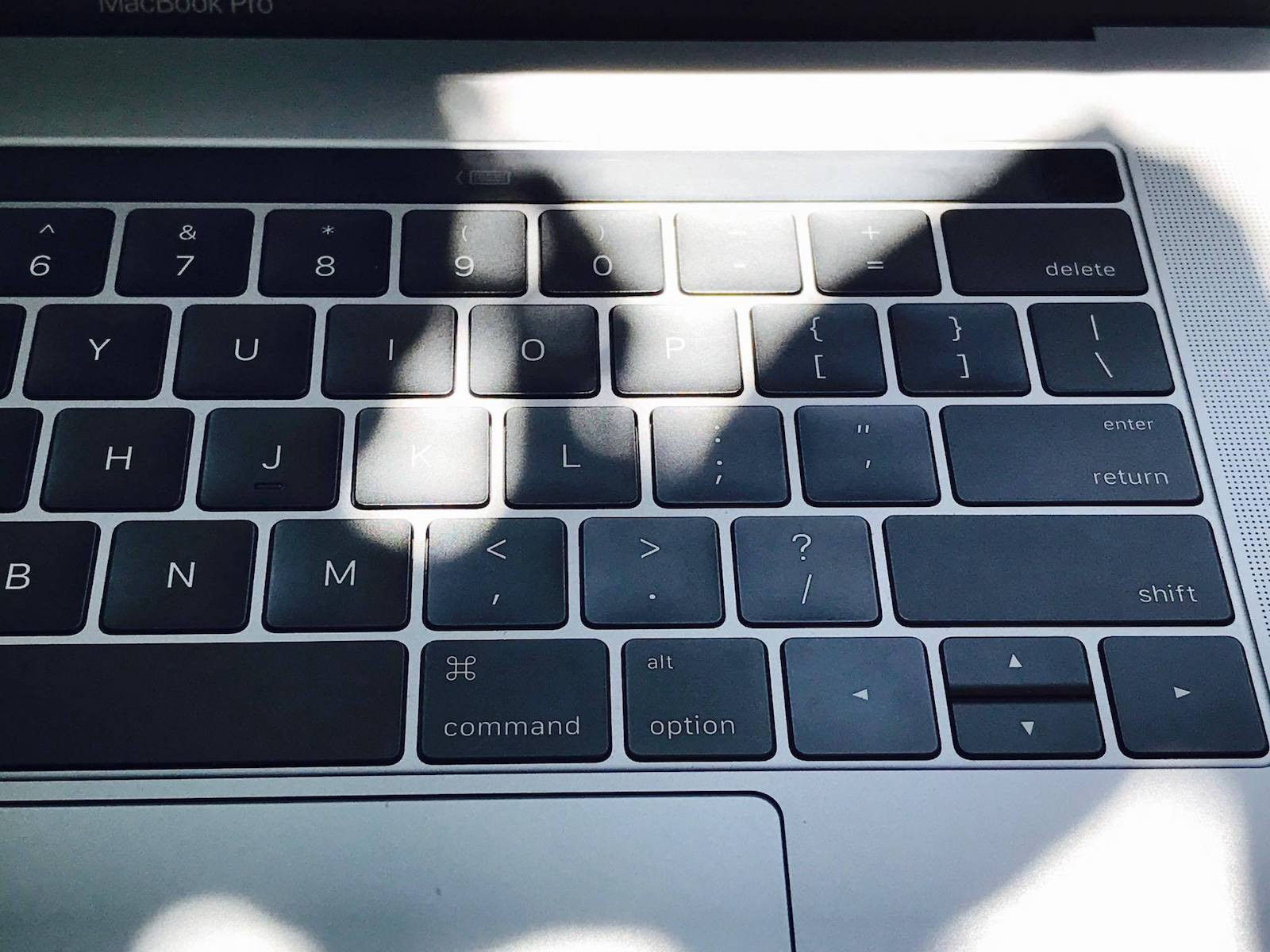You can't see TouchBar on MacBook Pro while the sun is shining.
