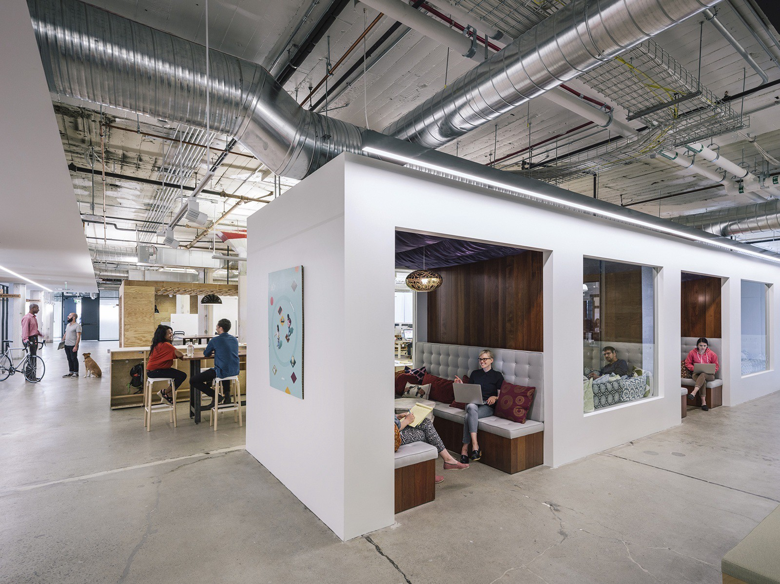 Interiors of an Airbnb office featuring their co-working spaces and themed meeting rooms