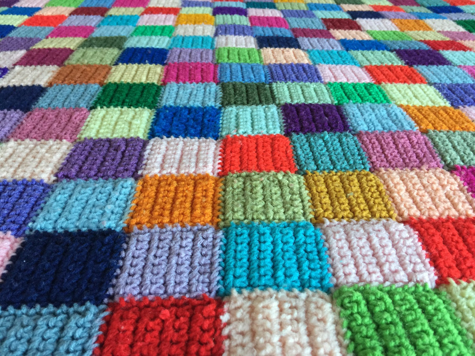 A crochet blanket made of 459 crochet squares