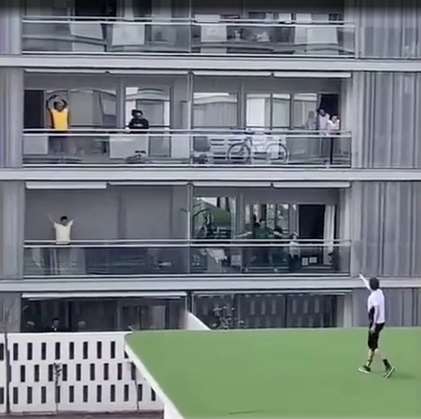 A man in Spain gives a rooftop aerobics class to his neighbours who are isolating during COVID-19