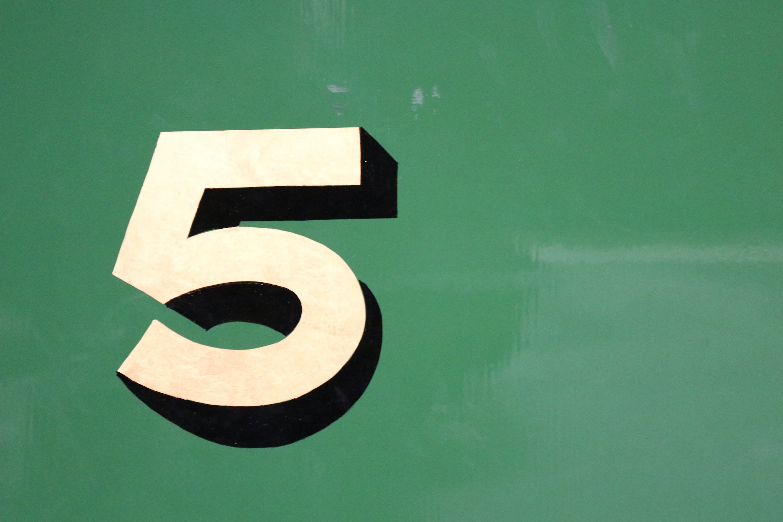 The number 5 on a green background