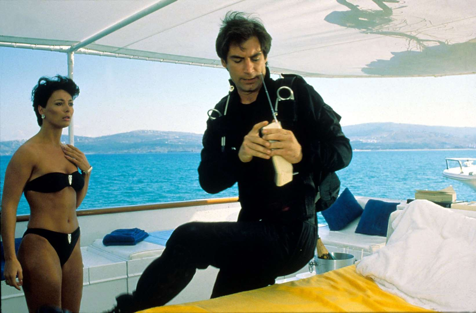 Still image from the movie The Living Daylights, where Bond meets a bikini-clad woman.