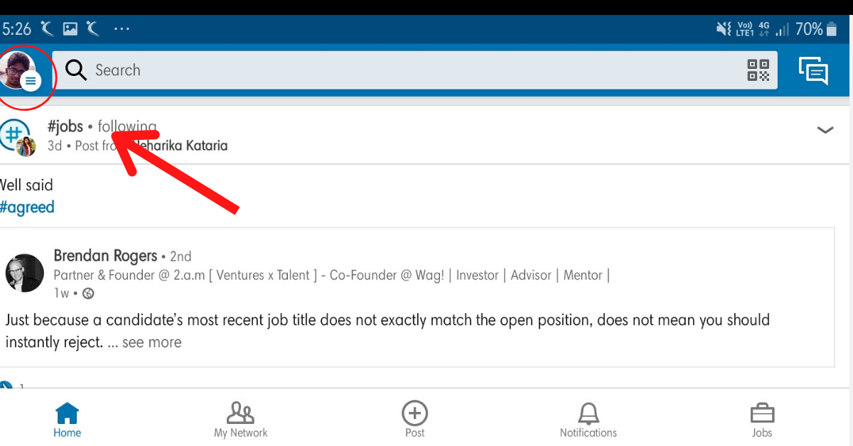 An arrow is pointing the profile icon placed in the top left beside the search bar inside the LinkedIn application's homepage.