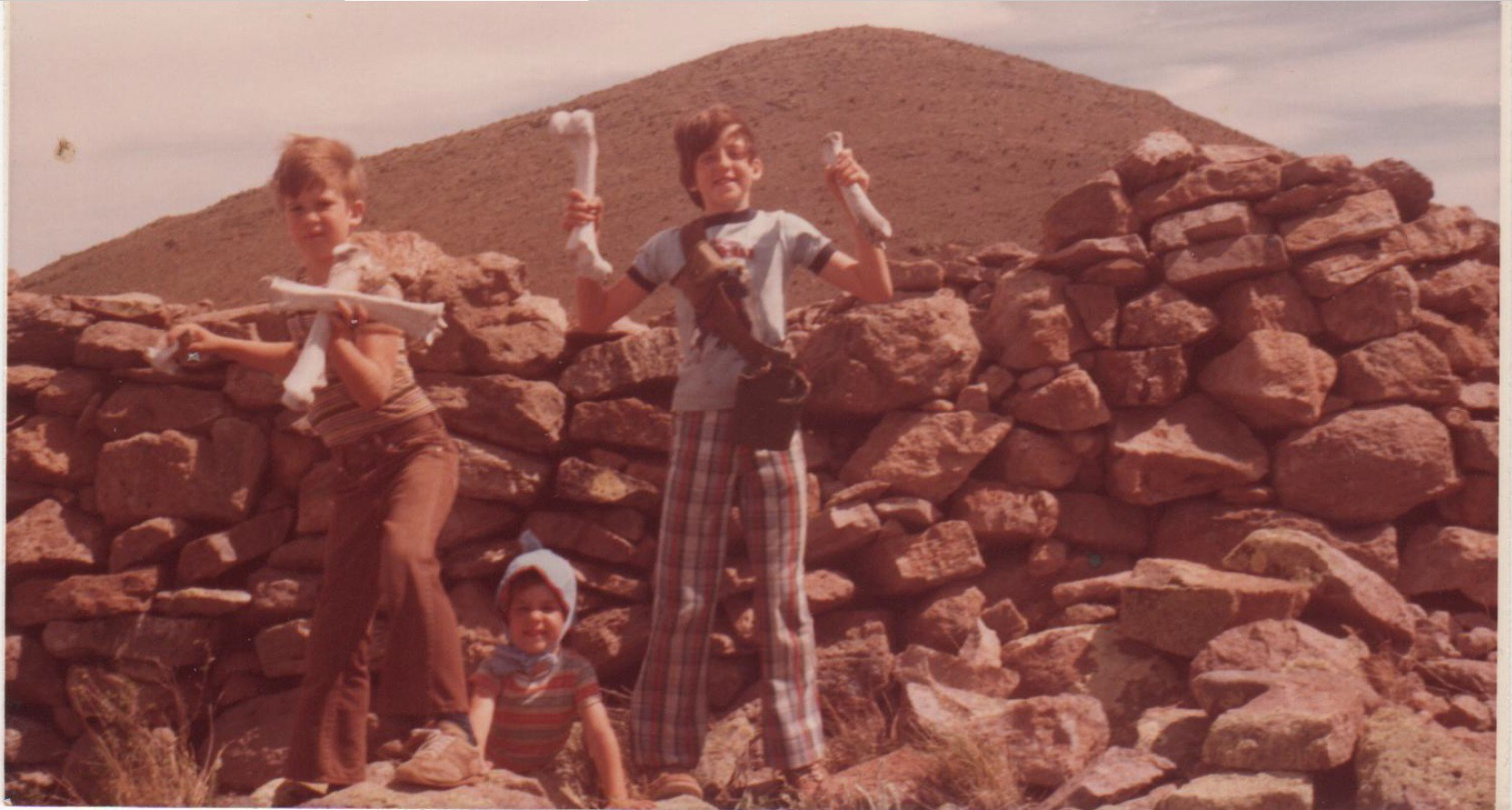 3 children posing near the summit of Pajarito mountain, Chihuahua.
