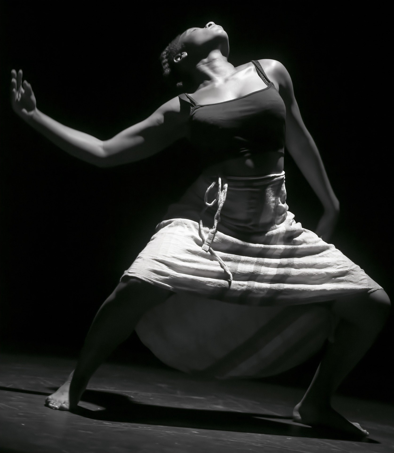 A black and white photo of a female dancer performing