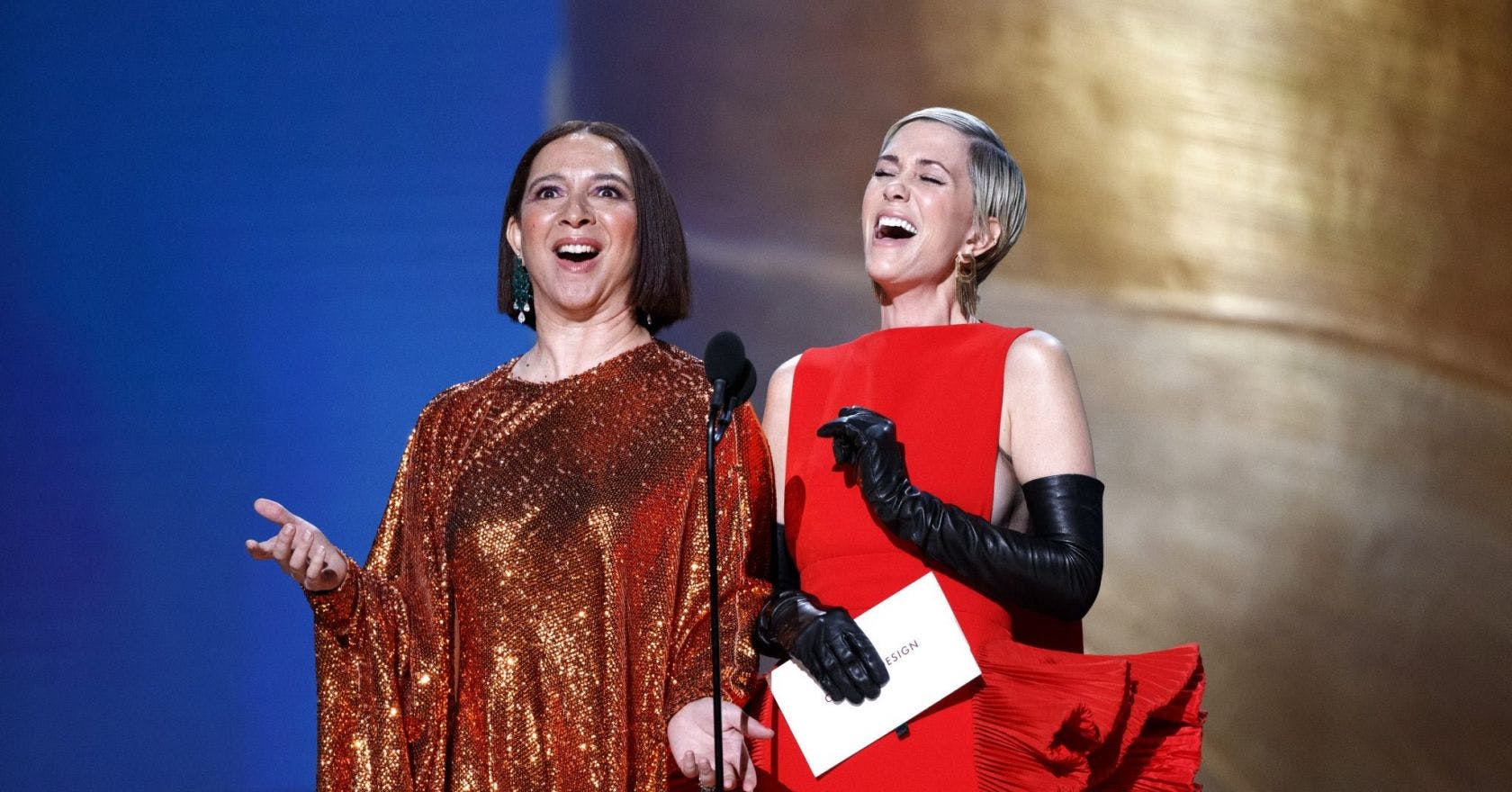 Maya Rudolph and Kristen Wiig singing on stage during the oscars 2020