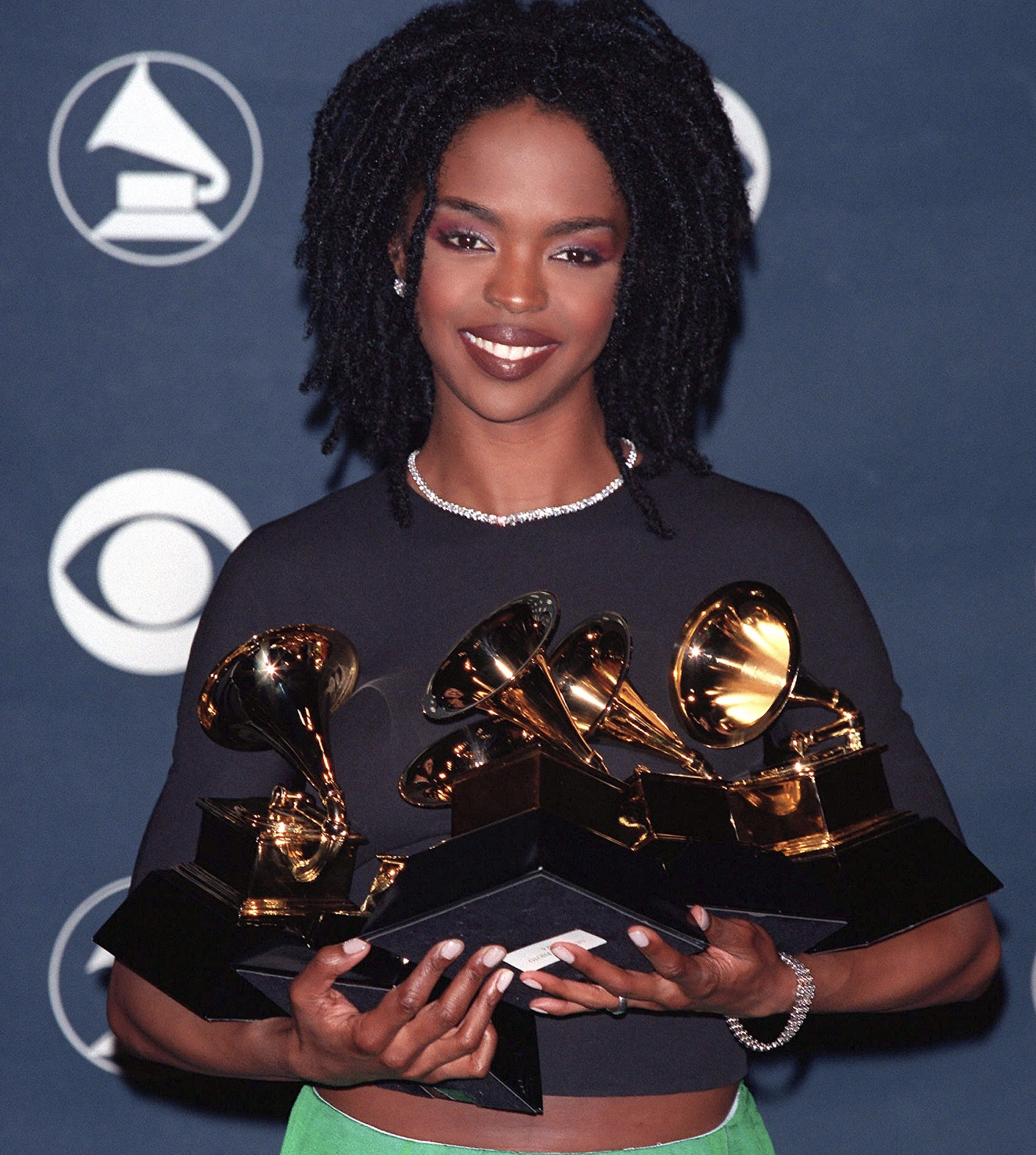 Image of Lauryn Hill holding her Grammys
